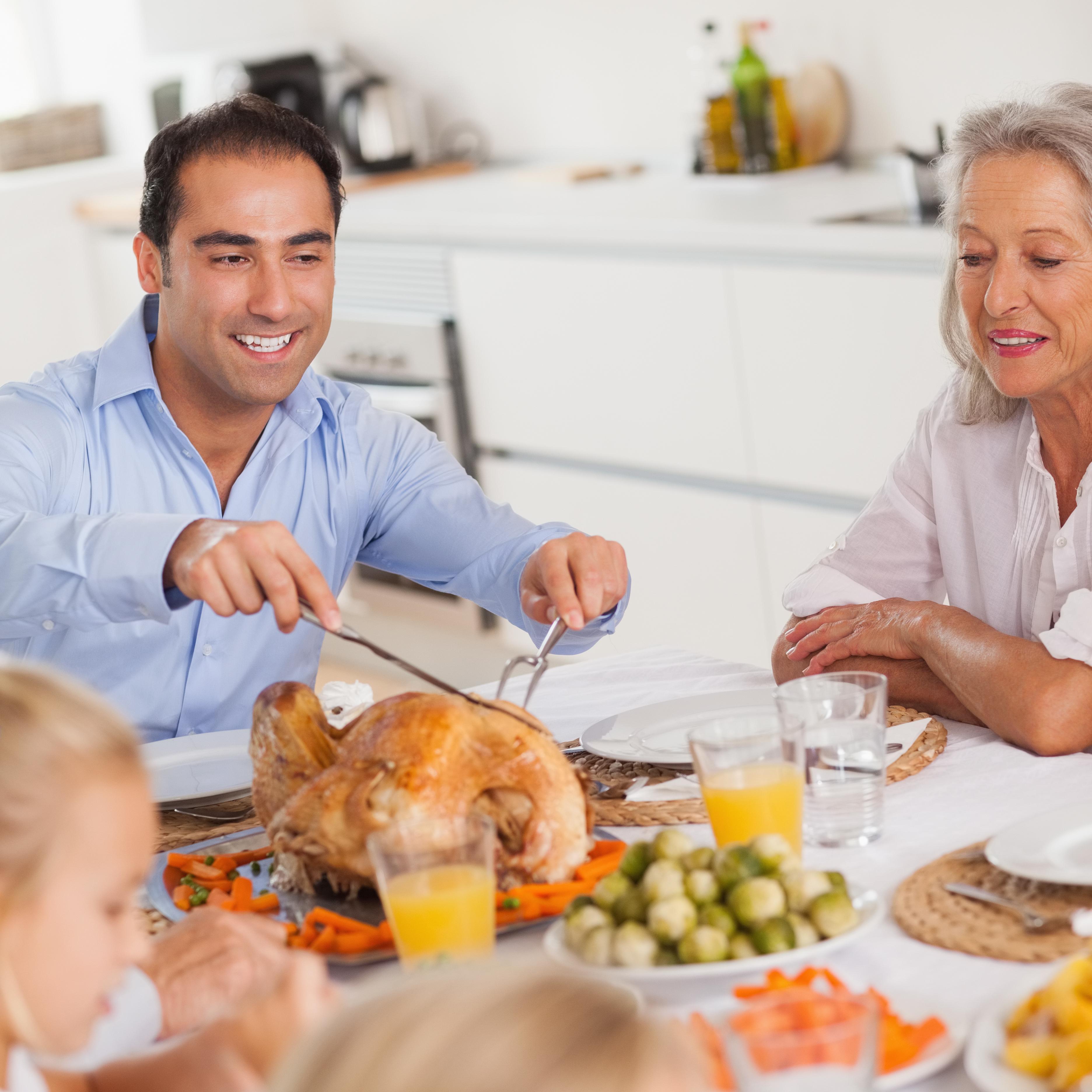 A man carves the Christmas turkey