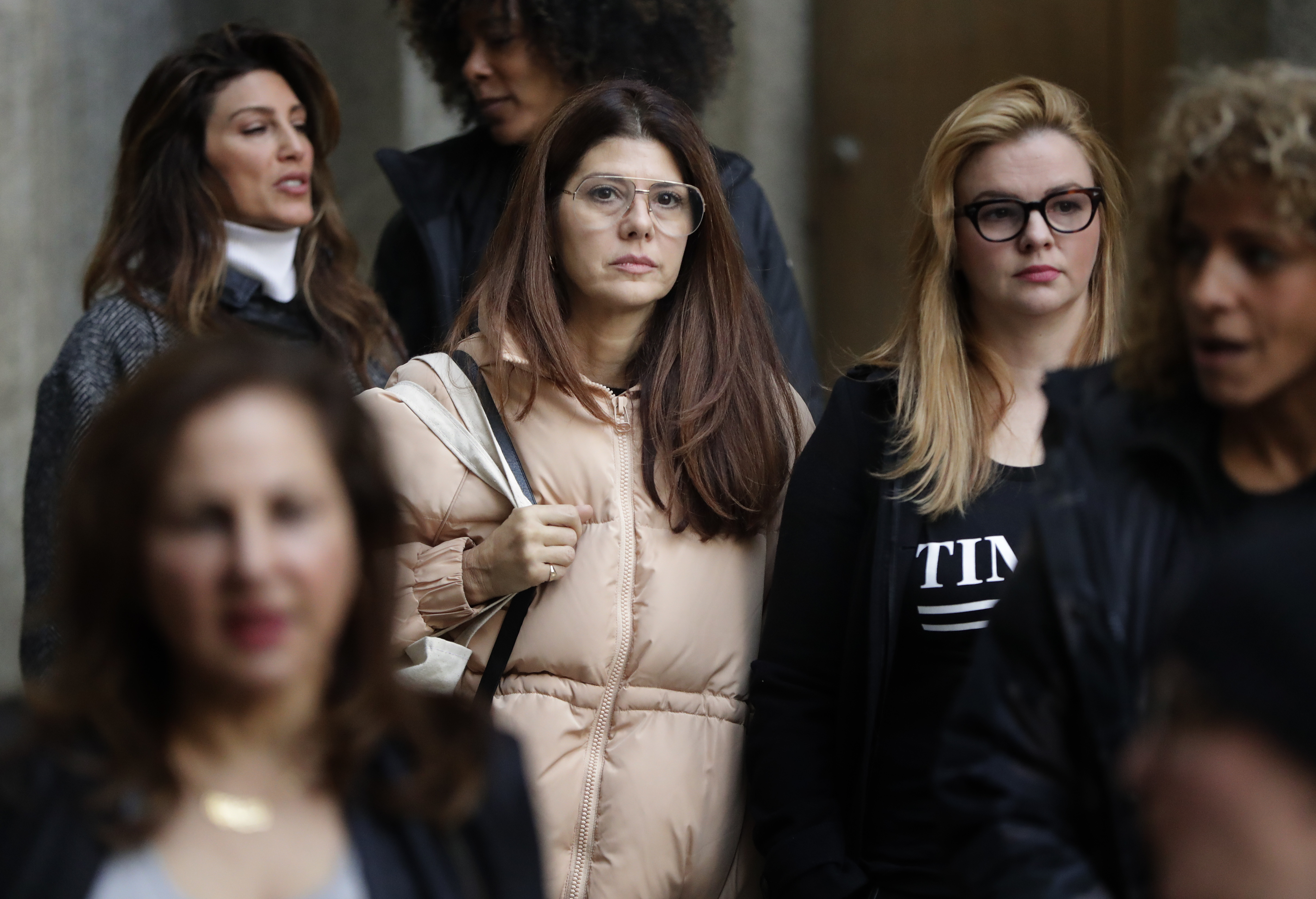 Marisa Tomei, centre, leaves New York Supreme Court