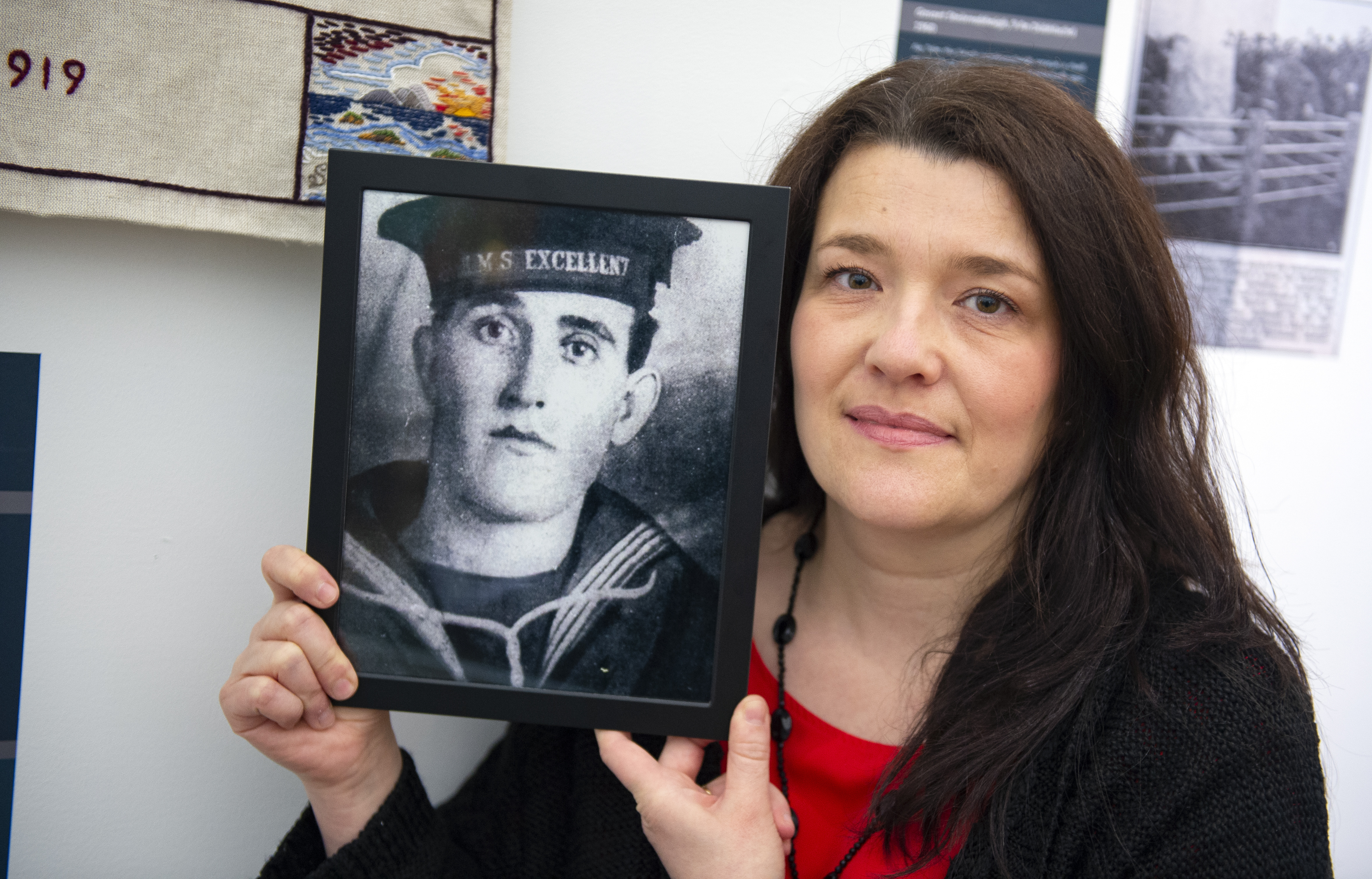 Sharon Smith, with picture of Malcolm Thomson