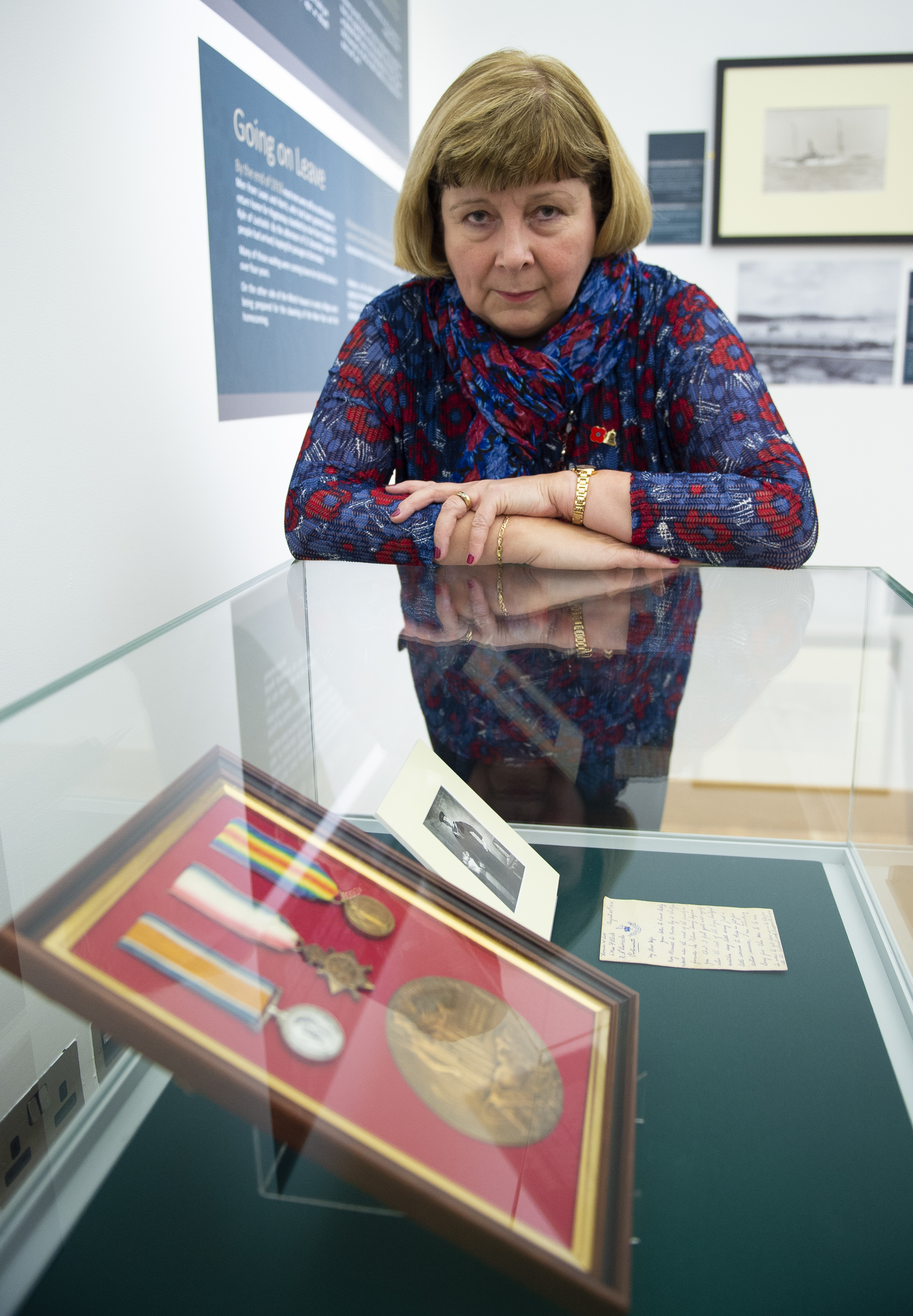Kathreen Hunter, granddaughter of Norman Macleod with his medals, death plaque and a letter