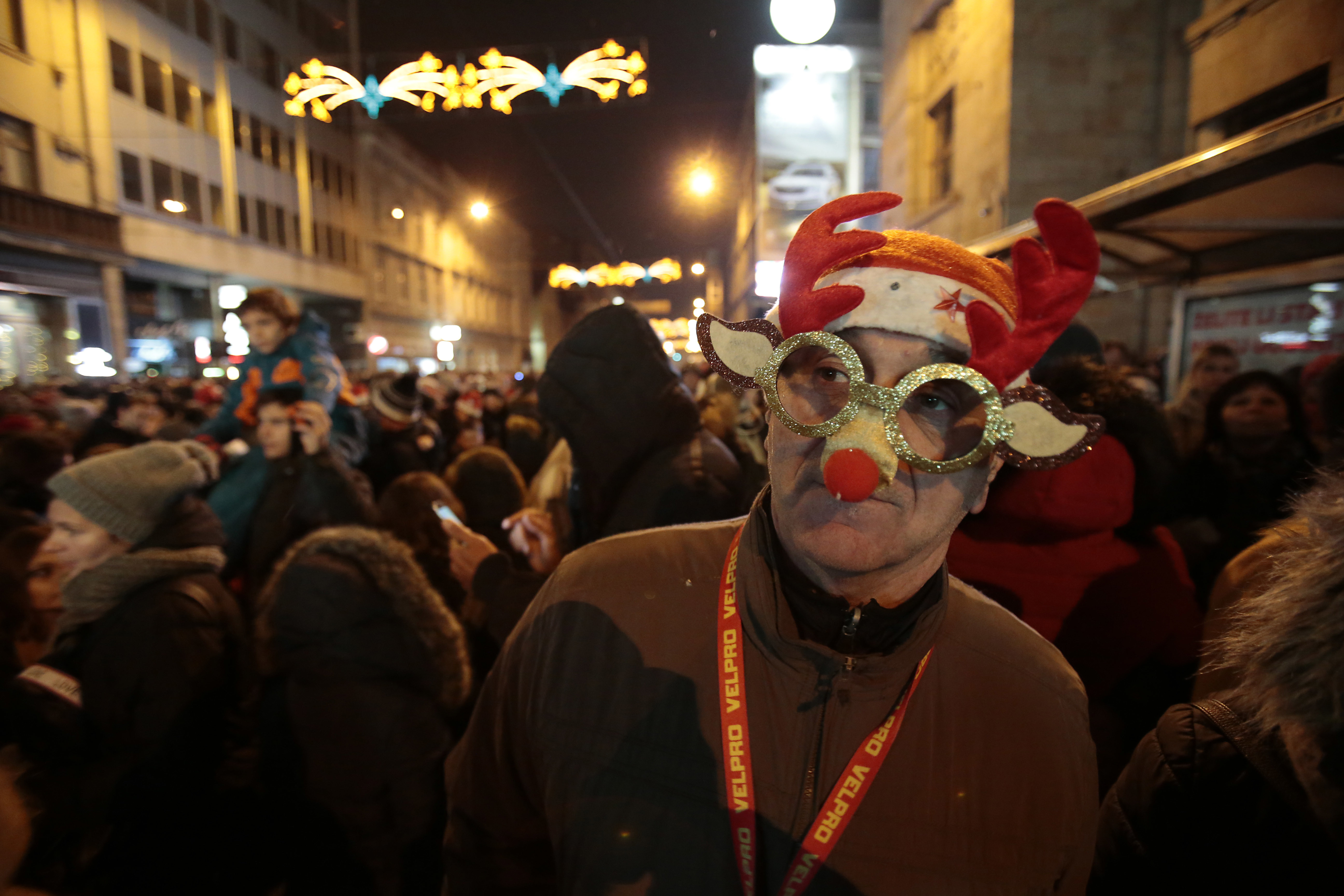 Bosnian people cheer during new year's celebrations in Sarajevo