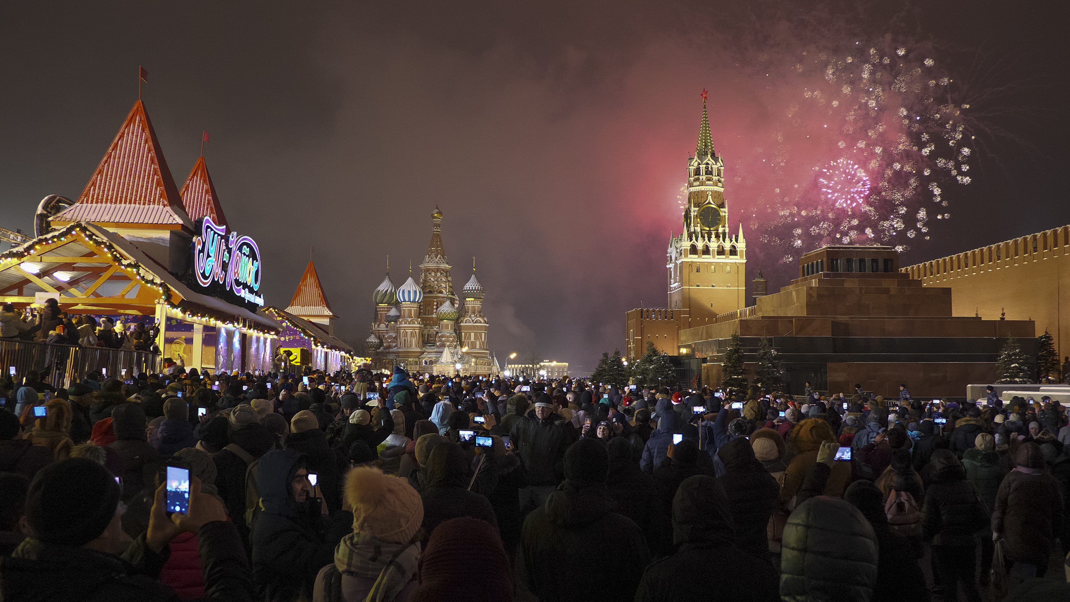 Fireworks explode over the Kremlin during New Year's celebrations in Red Square with St. Basil's Cathedral, center, and the Spasskaya Tower, right, in the background in Moscow, Russia