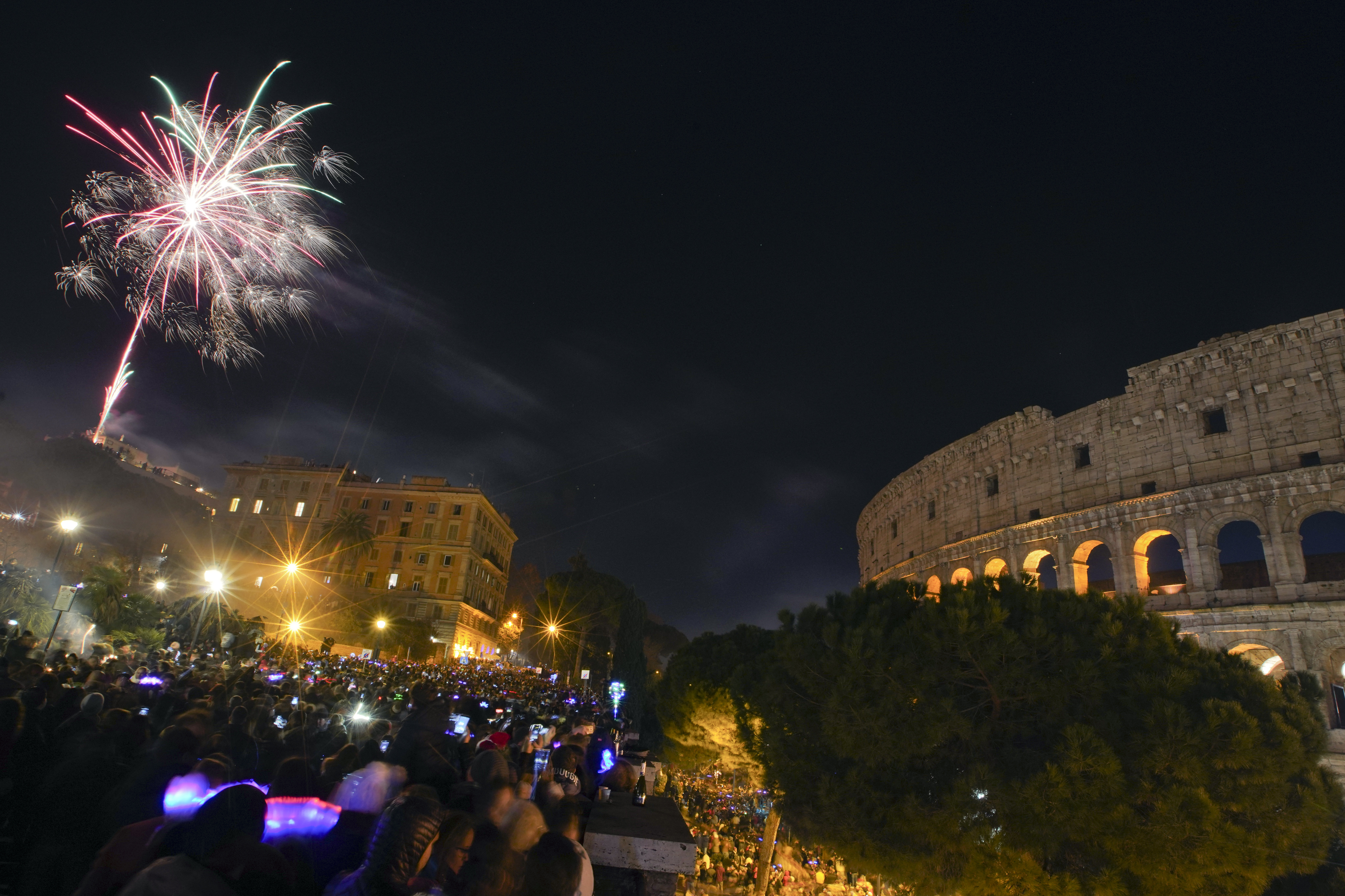 Fireworks explode in the sky over Rome's Colosseum during New Year's celebrations in Rome