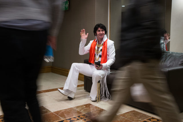 Mark Cumberland waves to passers by at Europe's largest annual Elvis Tribute Artist Content Convention