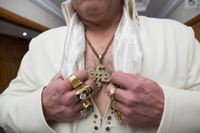 An Elvis performer shows off his jewellery