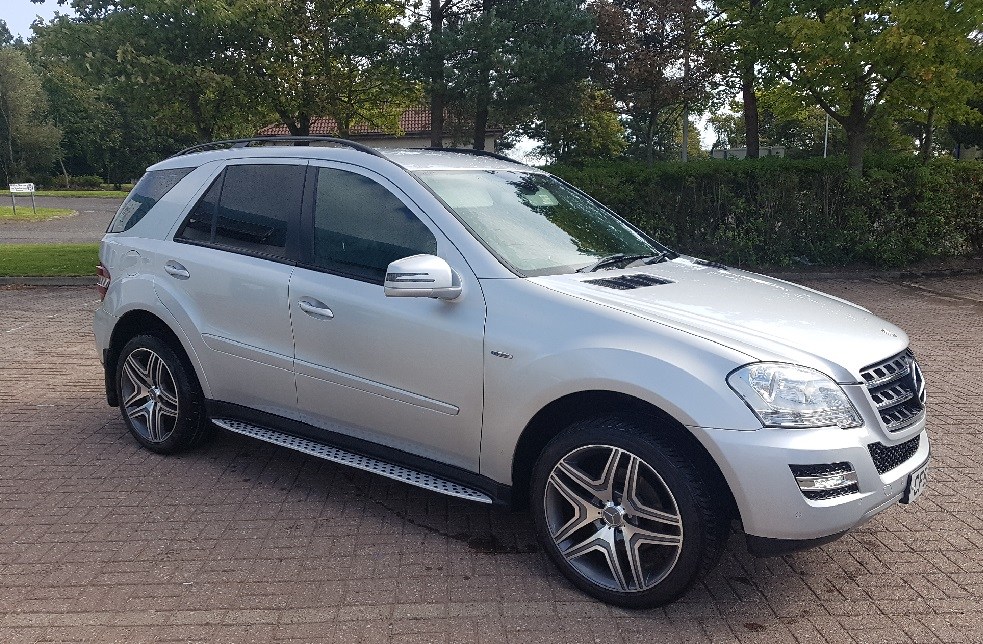 Silver Mercedez Benz ML350