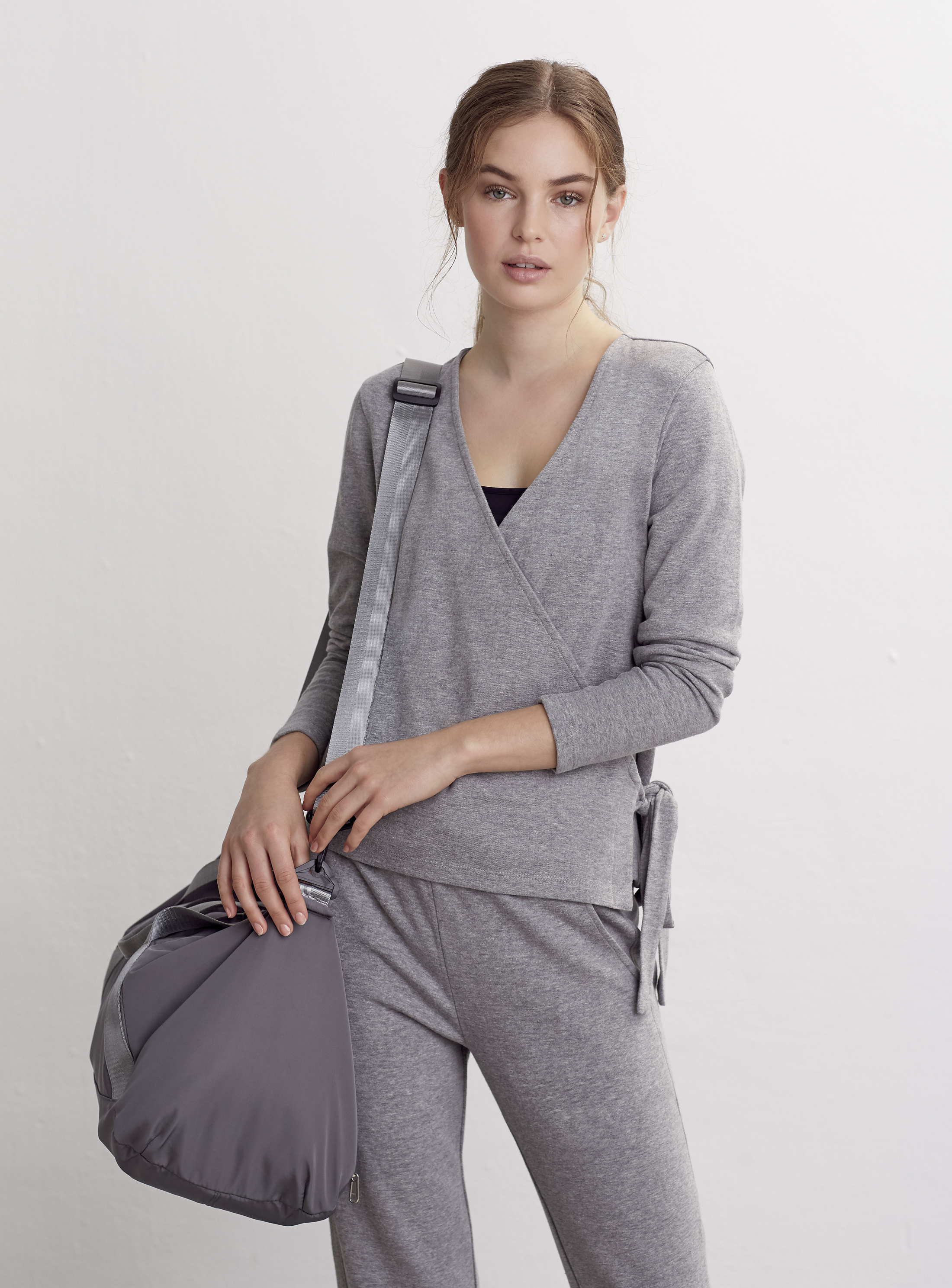 model wearing FatFace Athleisure Marnie Ballet Wrap Top; Athleisure Esme Tapered Joggers