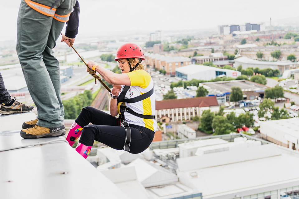 Corinne abseiling