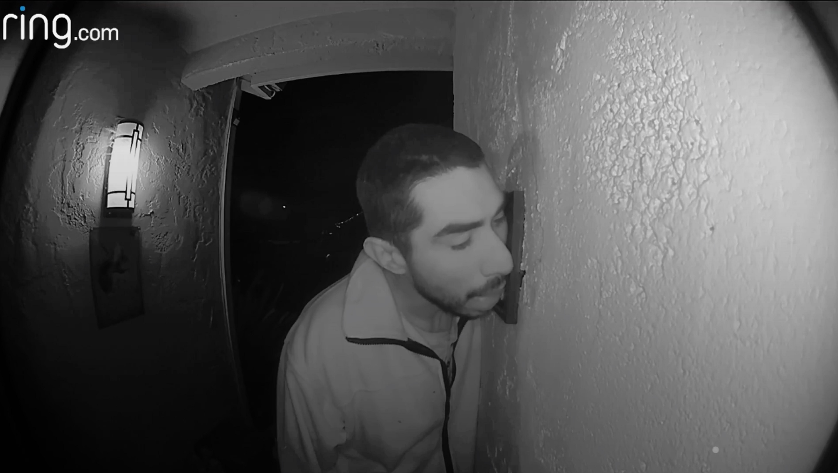 A man is caught on camera licking a home security system in Salinas, south of San Francisco