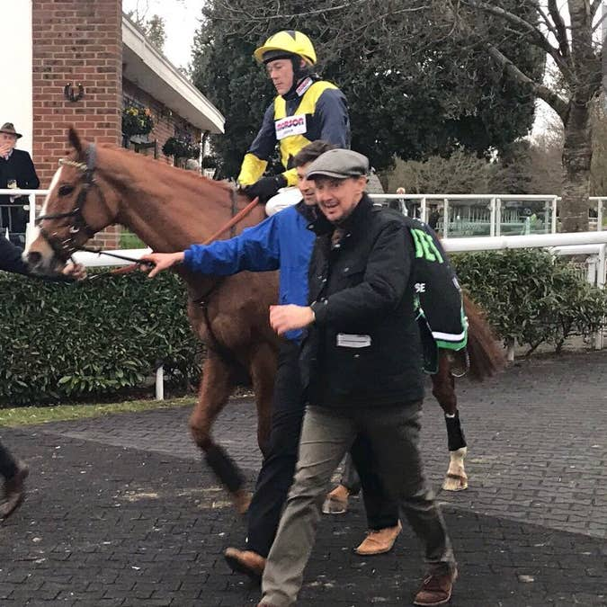 Jeremy Kyle (left) walks in with his star Glen Rocco following victory at Kempton