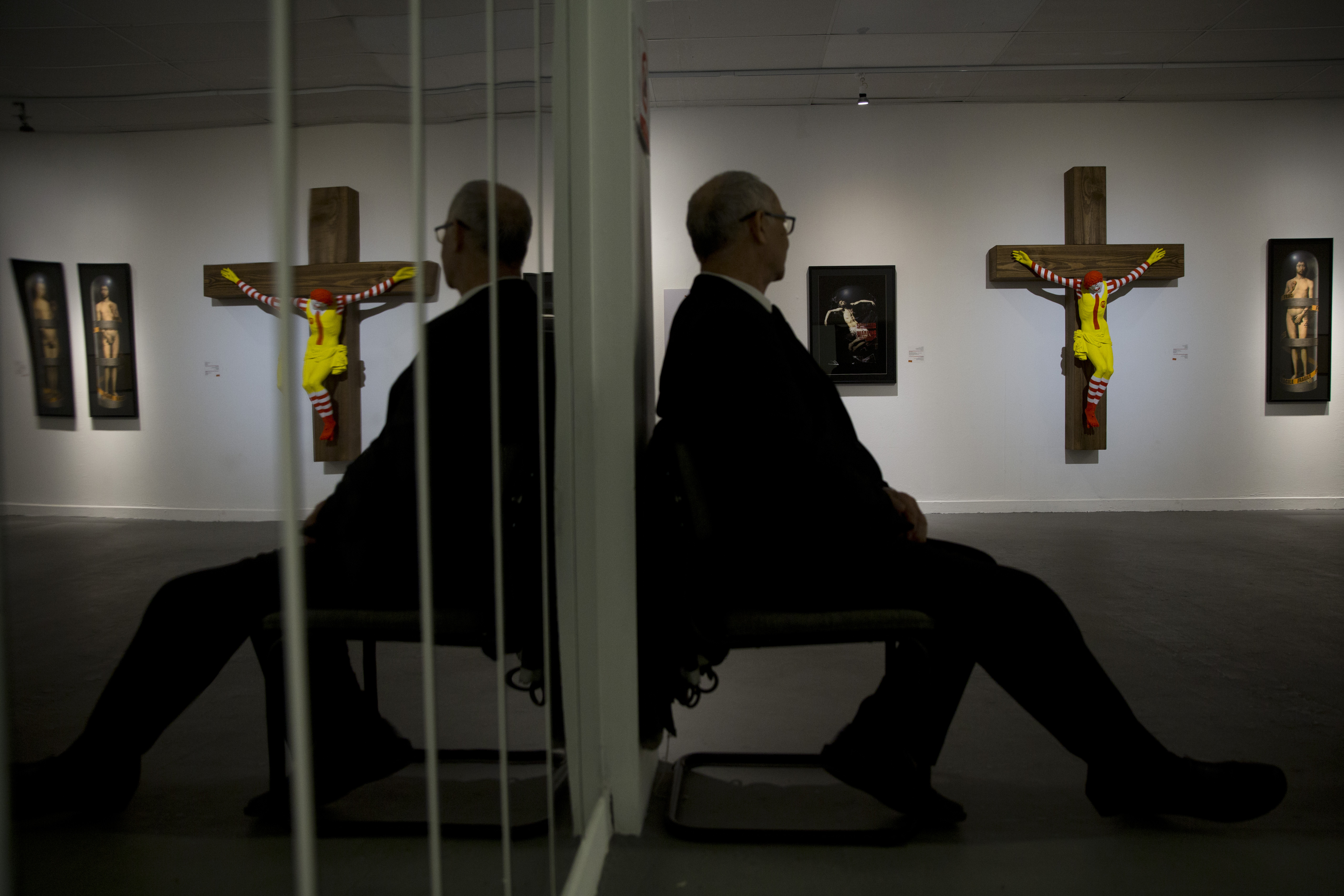 An artwork called McJesus, which was sculpted by Finnish artist Jani Leinonen and depicts a crucified Ronald McDonald, is seen on display as part of the Haifa museum's Sacred Goods exhibit in Haifa, Israel