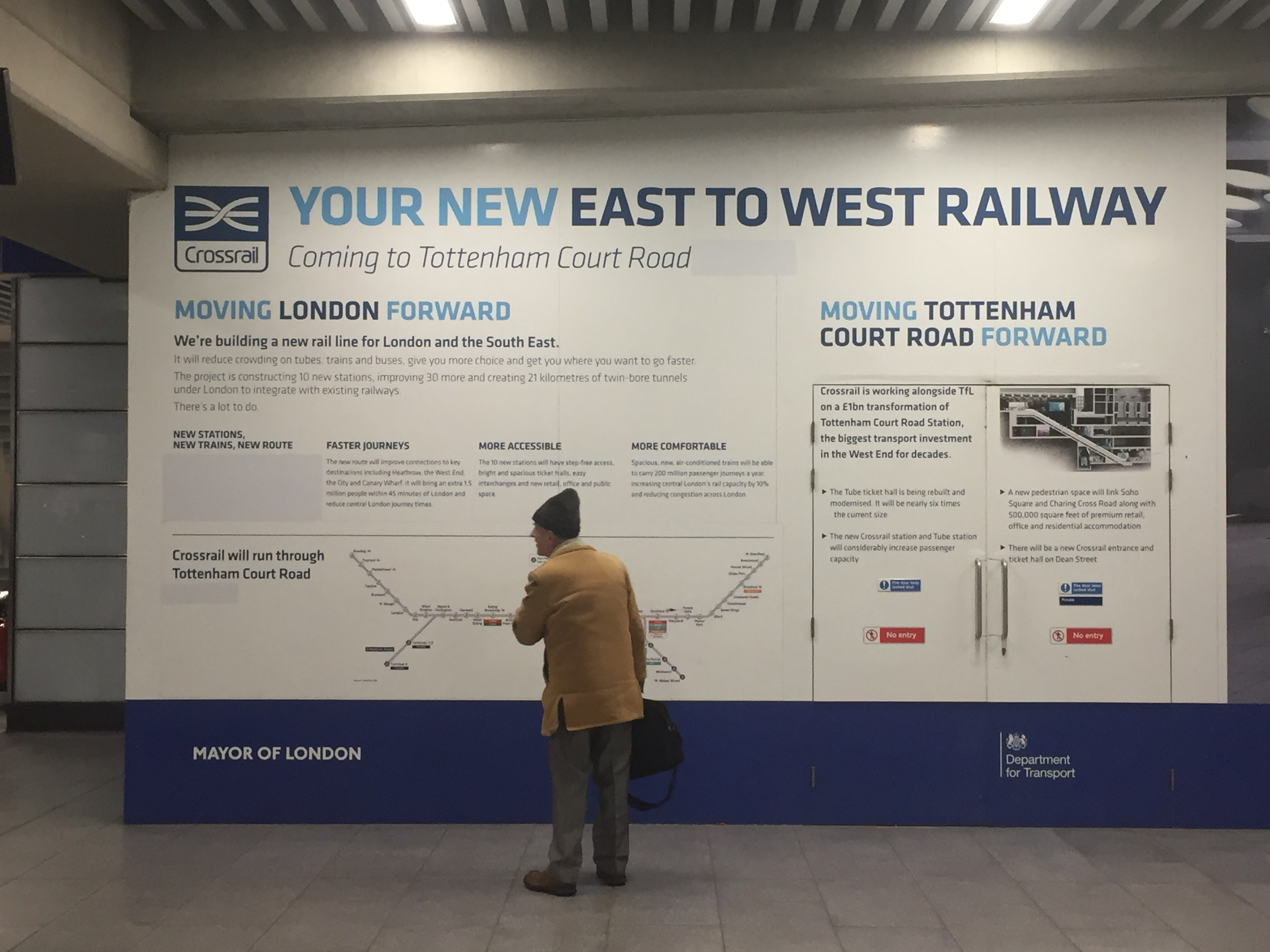 A Crossrail poster with references to 2018 covered up at Tottenham Court Road station (Neil Lancefield/PA)