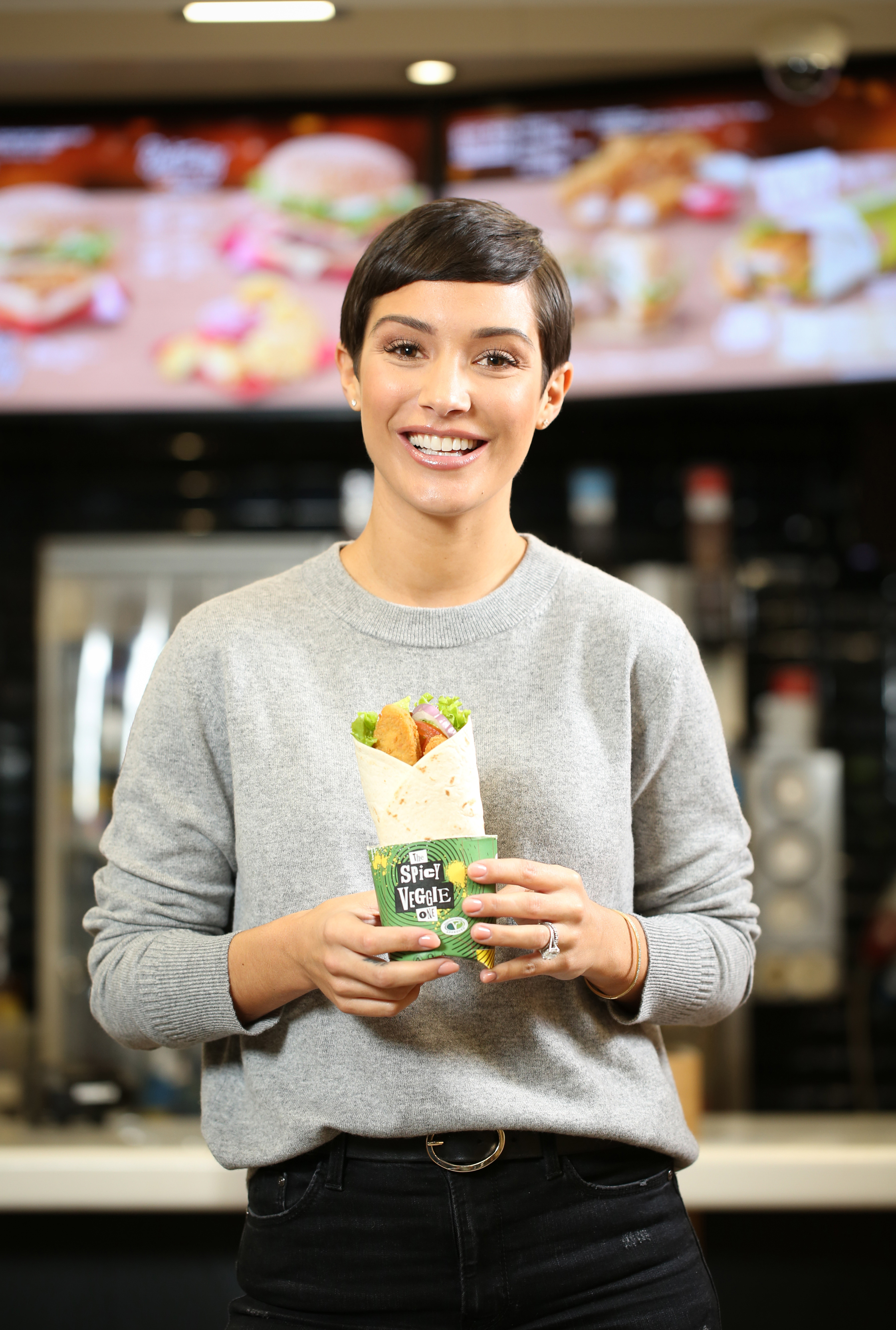 Frankie Bridge with a new Spicy Veggie Wrap on the menu at MacDonalds, as research reveals a third of McDonald's customers want to include more meat free meals into their household's diets. (Matt Alexander/PA)