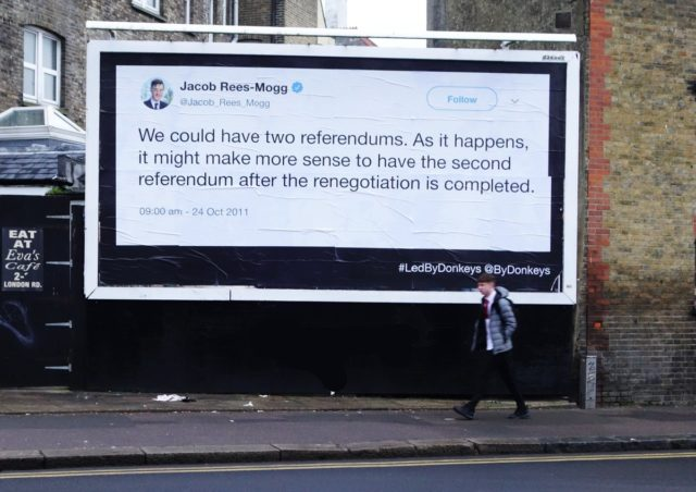 A billboard showing Jacob Rees-Mogg suggesting the possiblity of two EU referendums