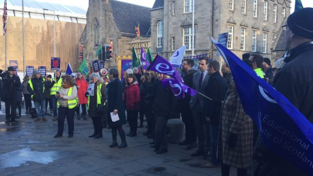 Striking Scottish college lecturers protesting outside the Scottish Parliament in Edinburgh