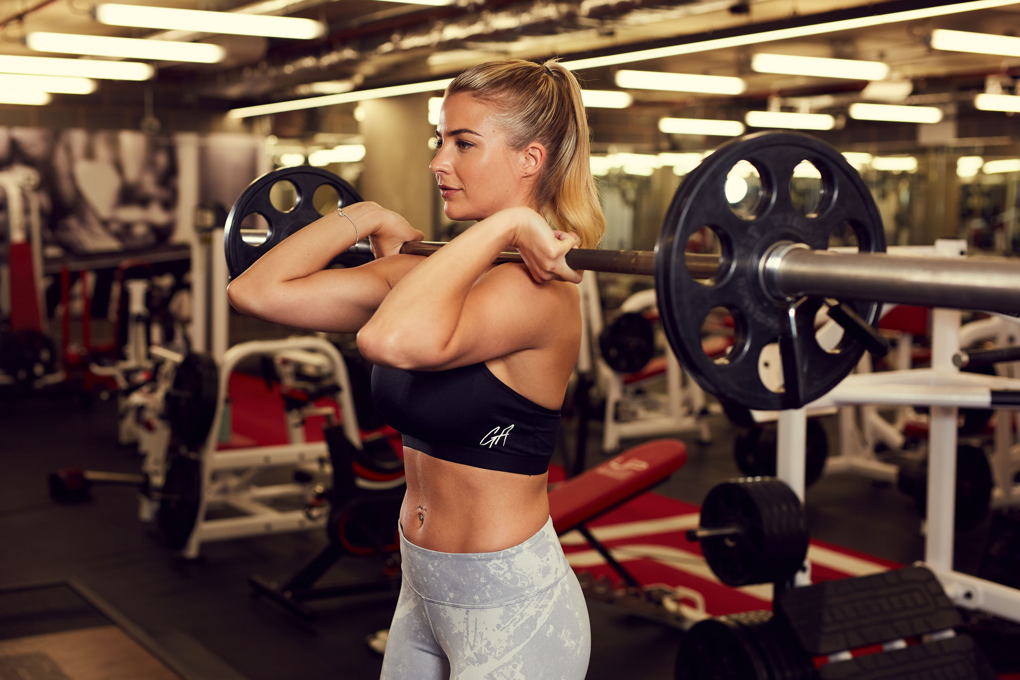 Gemma Atkinson working out with weights (David Cummings/The Ultimate Body Plan/Harper Thorsons/PA)