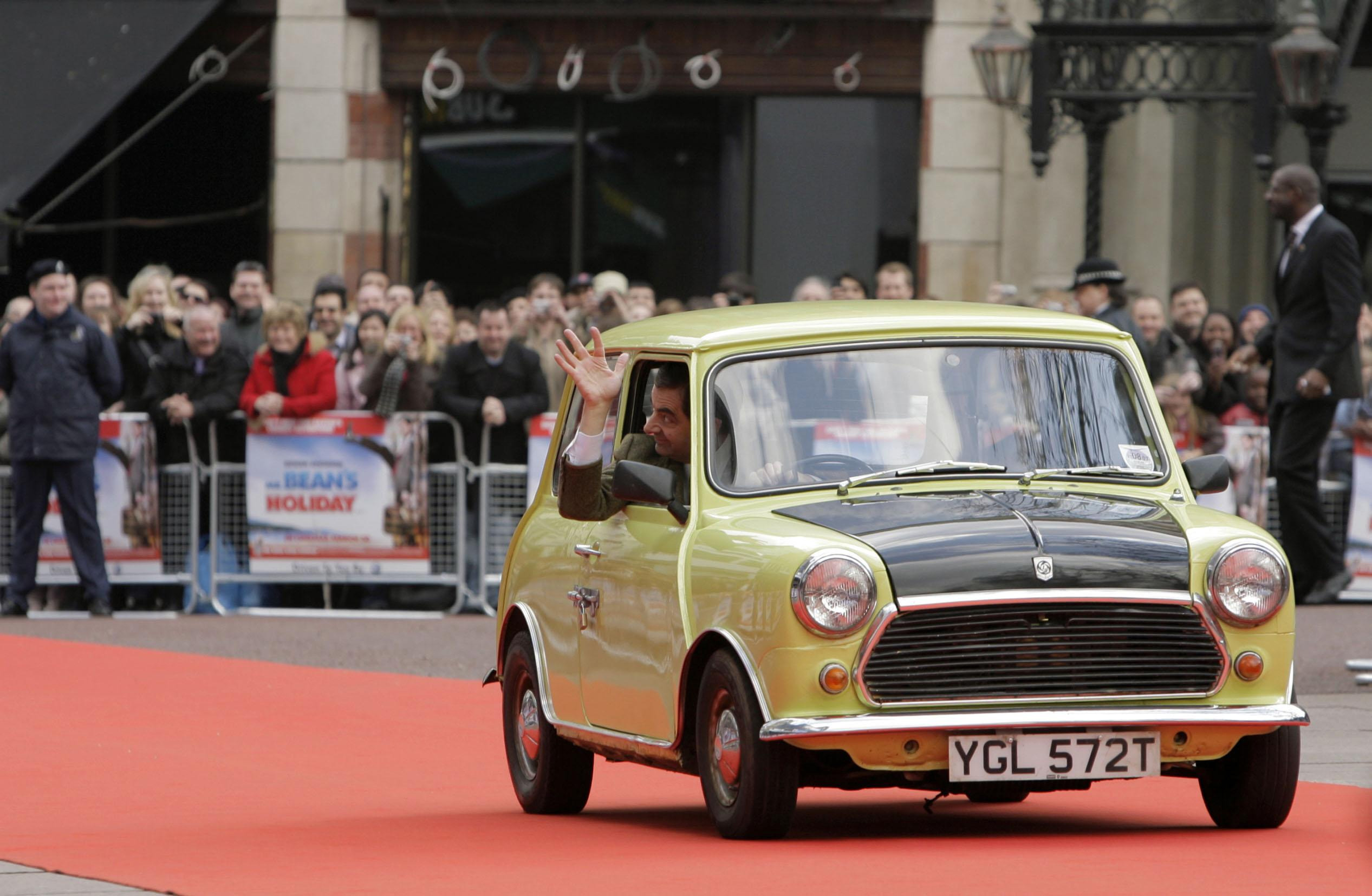 Rowan Atkinson arrives at the Mr Bean premiere in a Mini