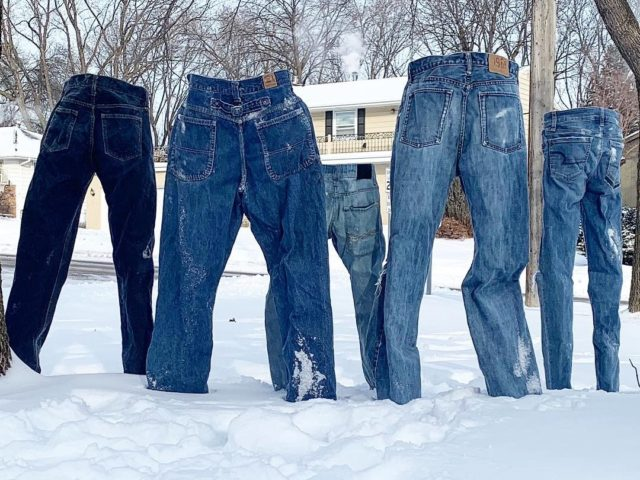 The pants in the snow, from behind
