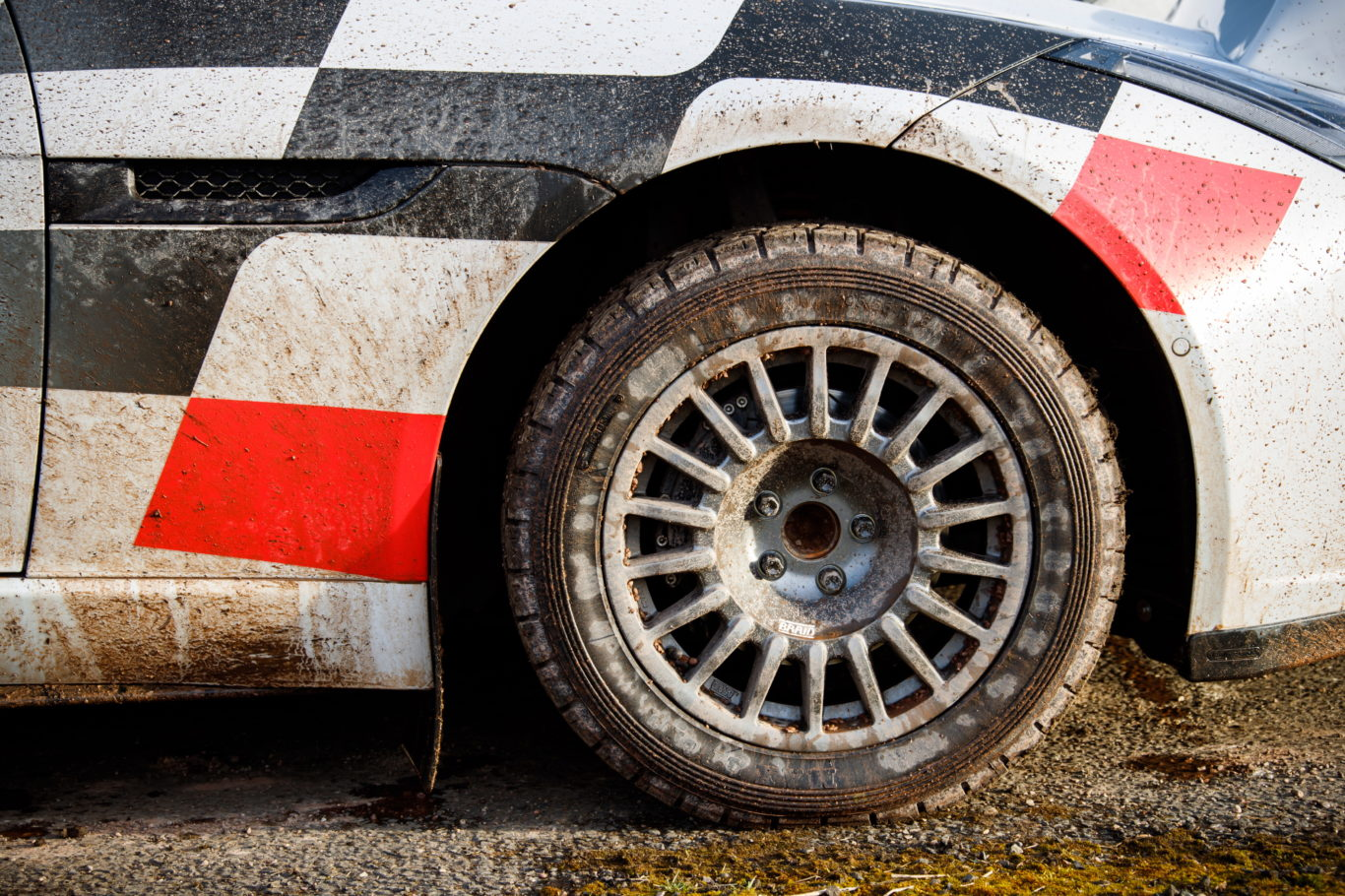 The rally car uses 16-inch wheels with knobbly tyres