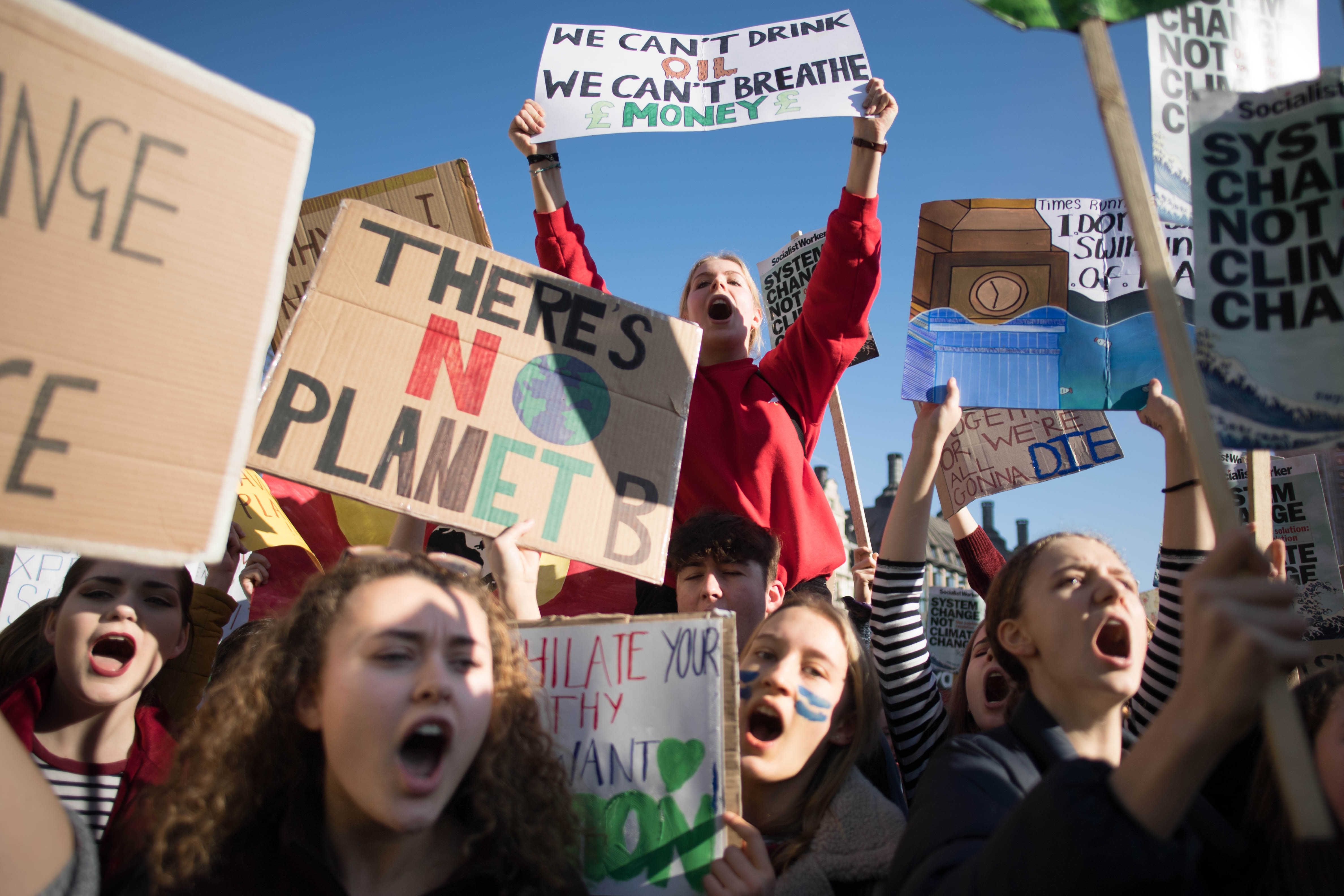 Students from the Youth Strike 4 Climate movement during a climate change protest on Parliament Square in Westminster, London
