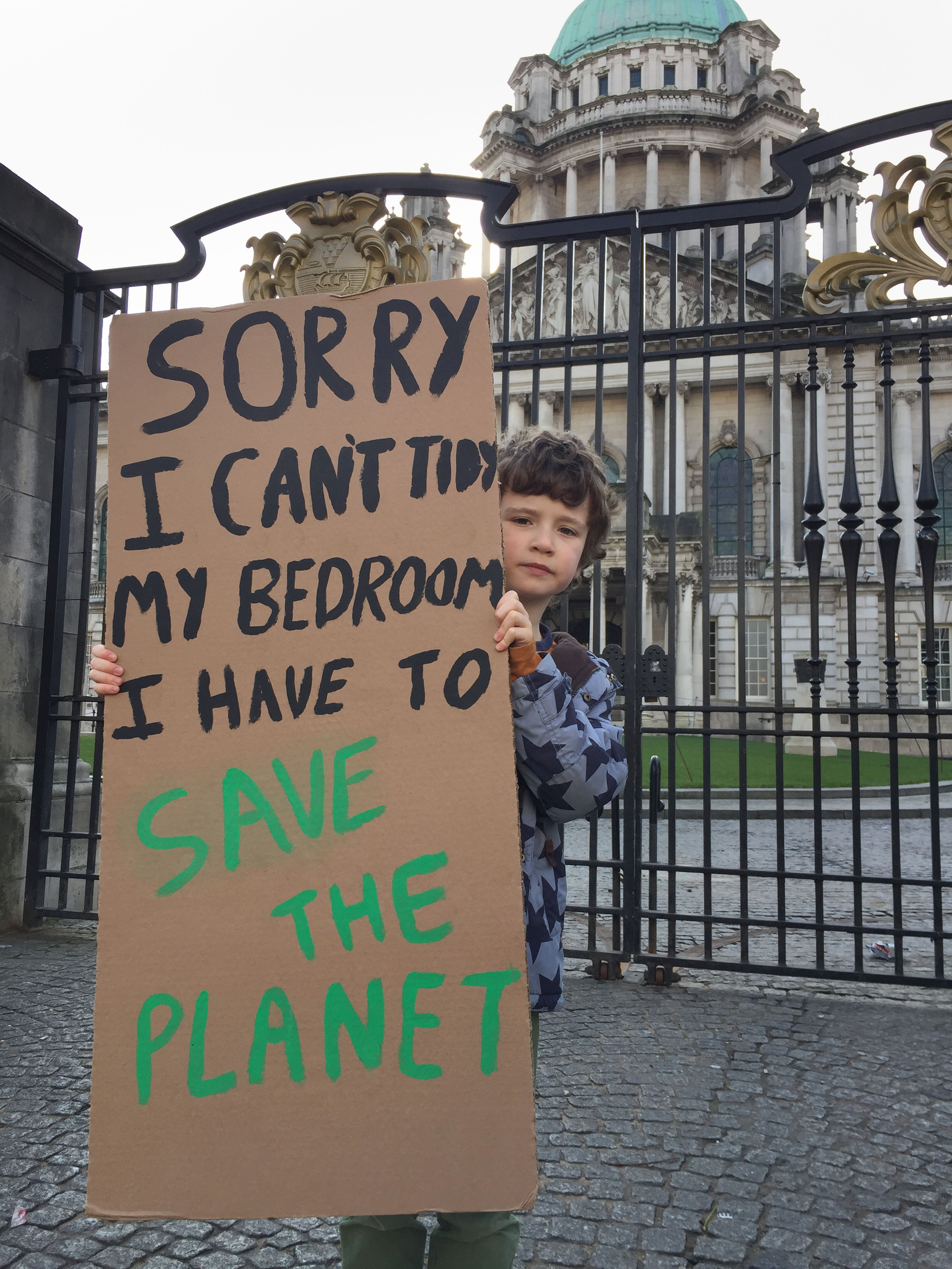 Archie Agnew, aged 8, at a climate change protest outside Belfast City Hall