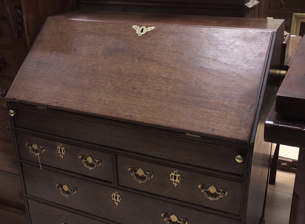 The 20th century George-II style wooden bureau where the coin was found. (Phil Barnett/PA Images)