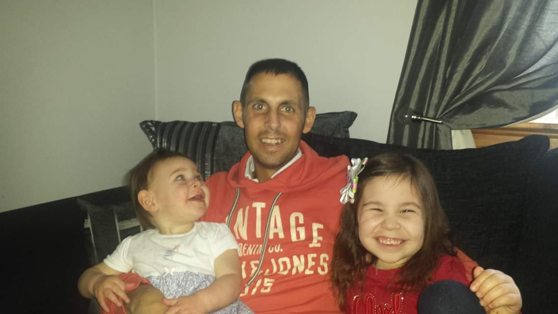 Mr Sutherland with his daughters, after coming out of a coma (Family handout/ PA)