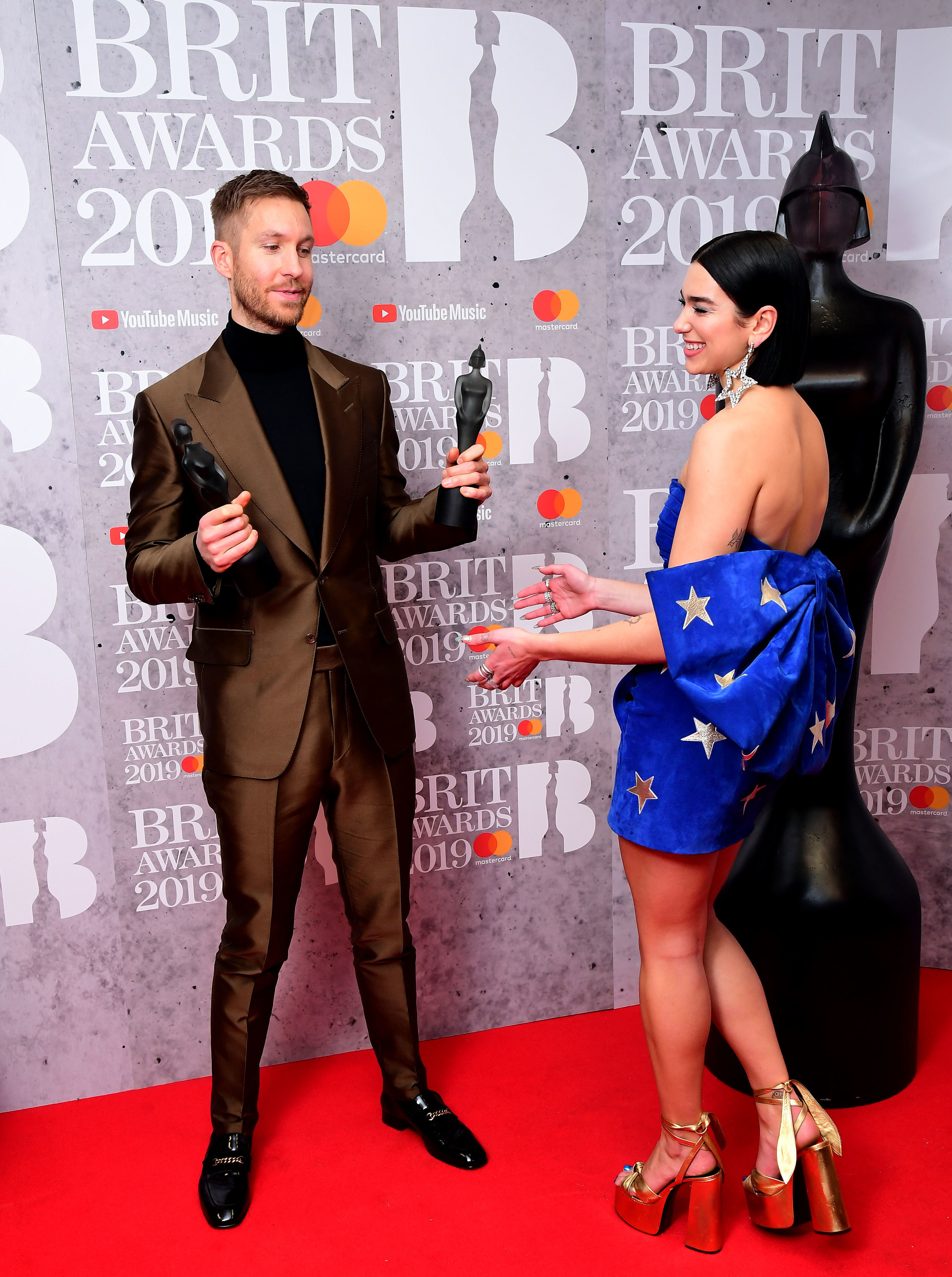 Dua Lipa and Calvin Harris with their Best British Single Brit Award