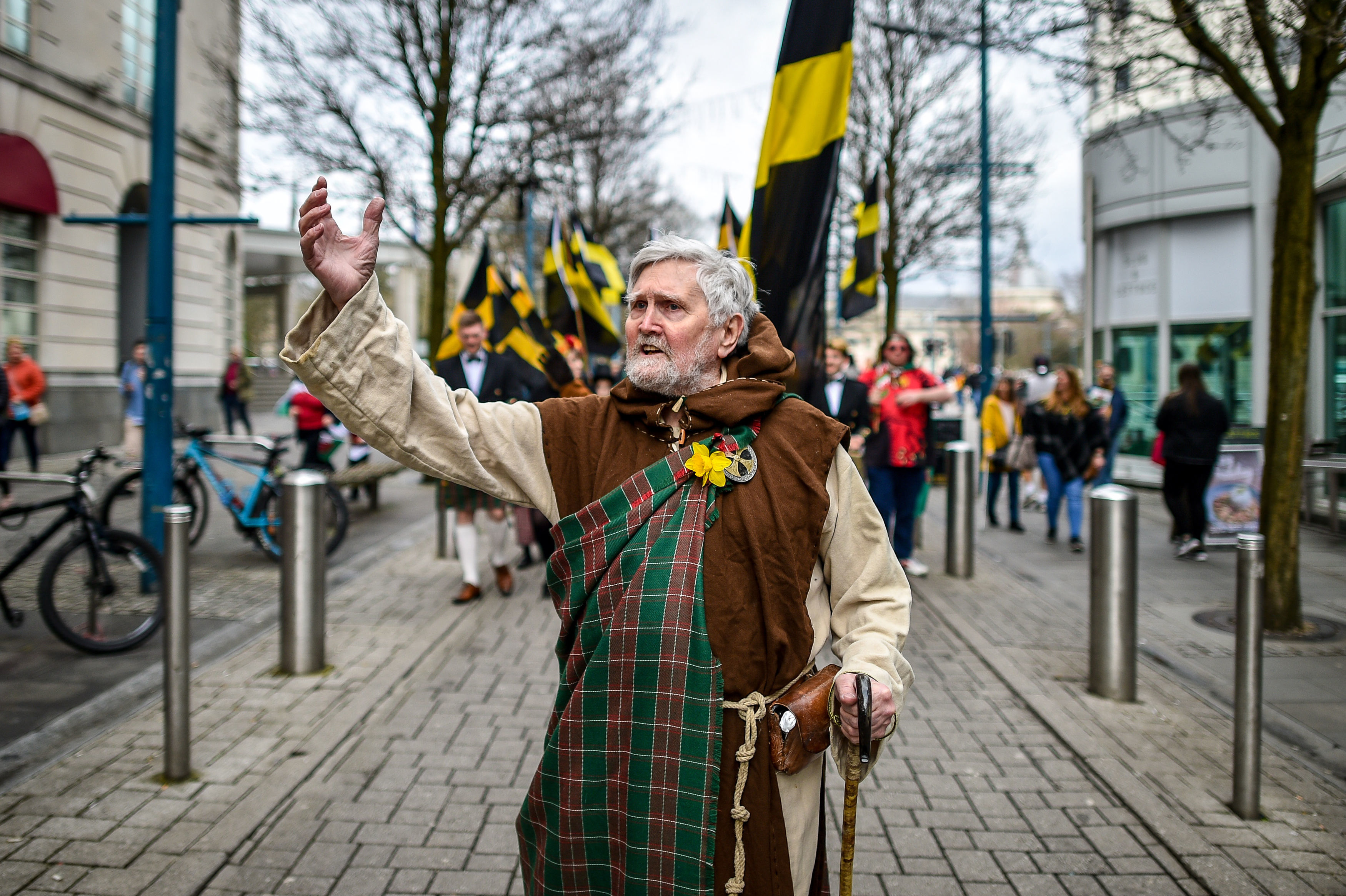 A man dressed as St David leads the way during a St David's Day Parade in Cardiff