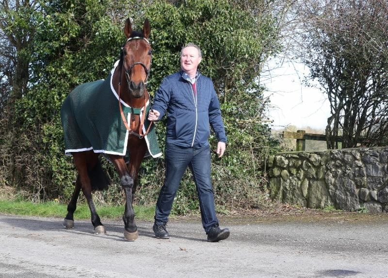 Trainer Pat Kelly with Presenting Percy at his stable in Athenry, County Galway