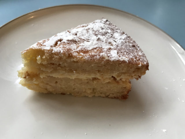 A slice of apple and lemon cake from Mary Berry Quick Cooking made by Prudence (Prudence Wade/PA)