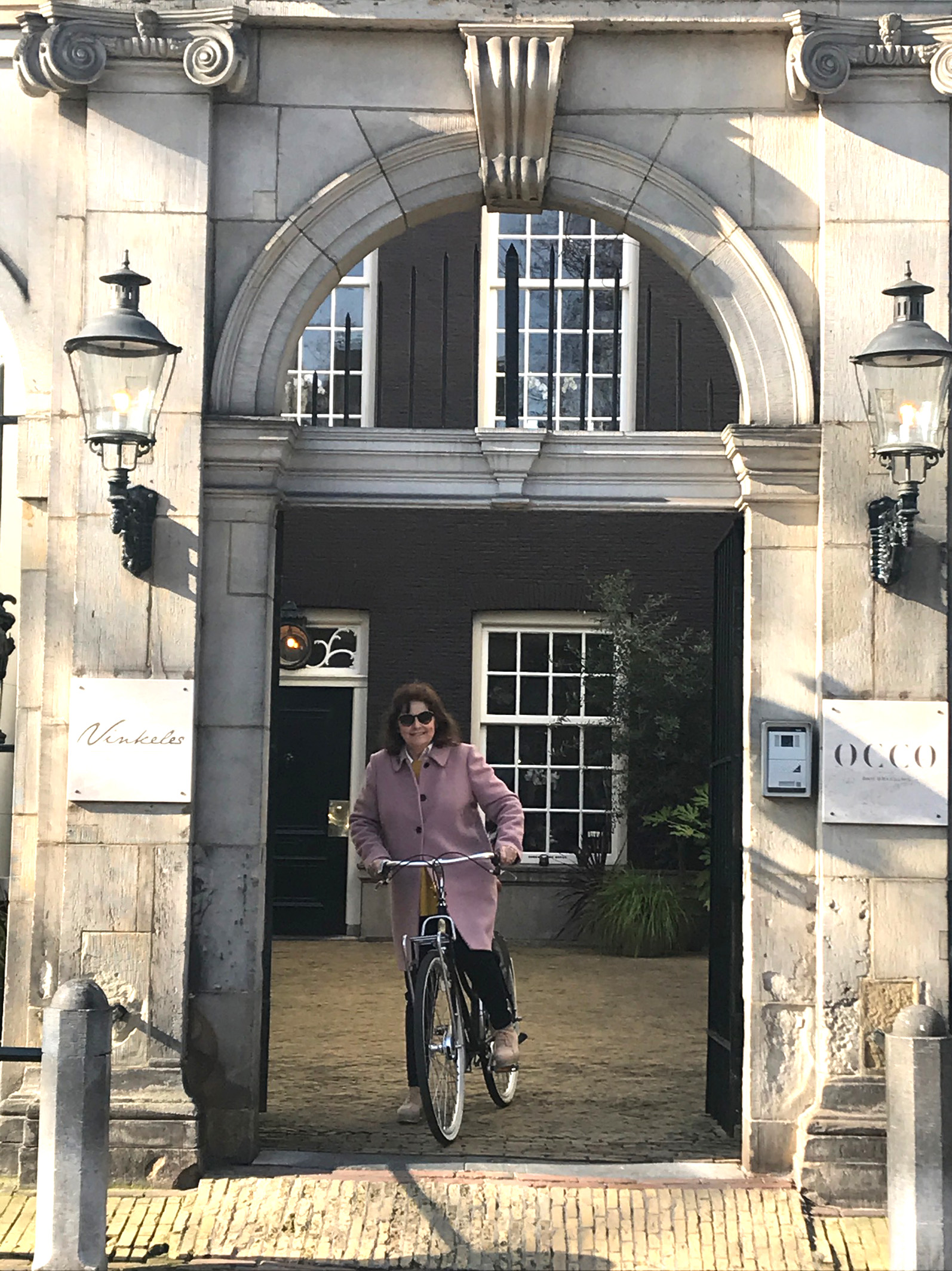 Gabrielle Fagan in the courtyard entrance to the Dylan Hotel, in the heart of Amsterdam's most fashionable district, The Nine Streets (Gabrielle Fagan/PA)