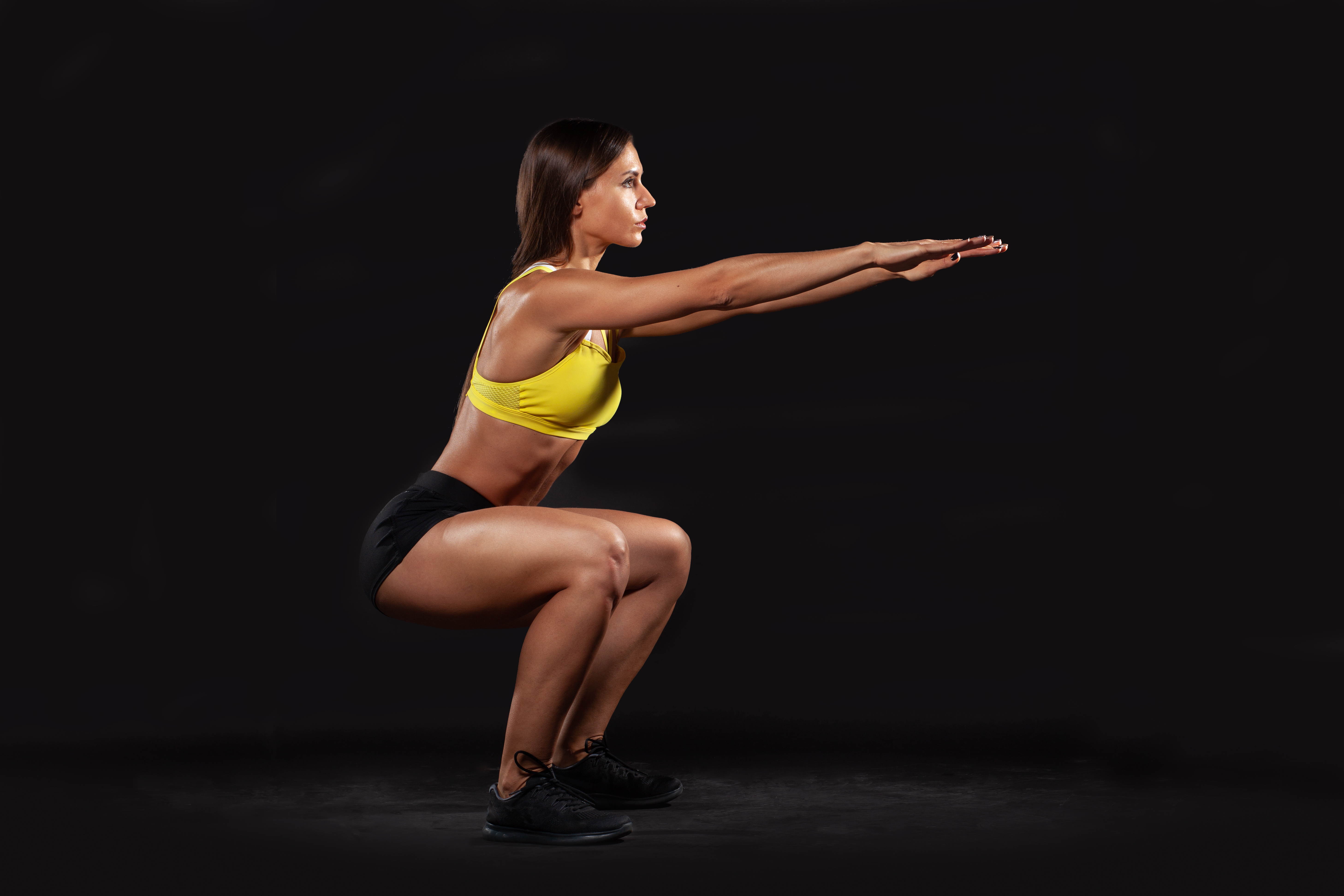 fitness female doing squat exercise