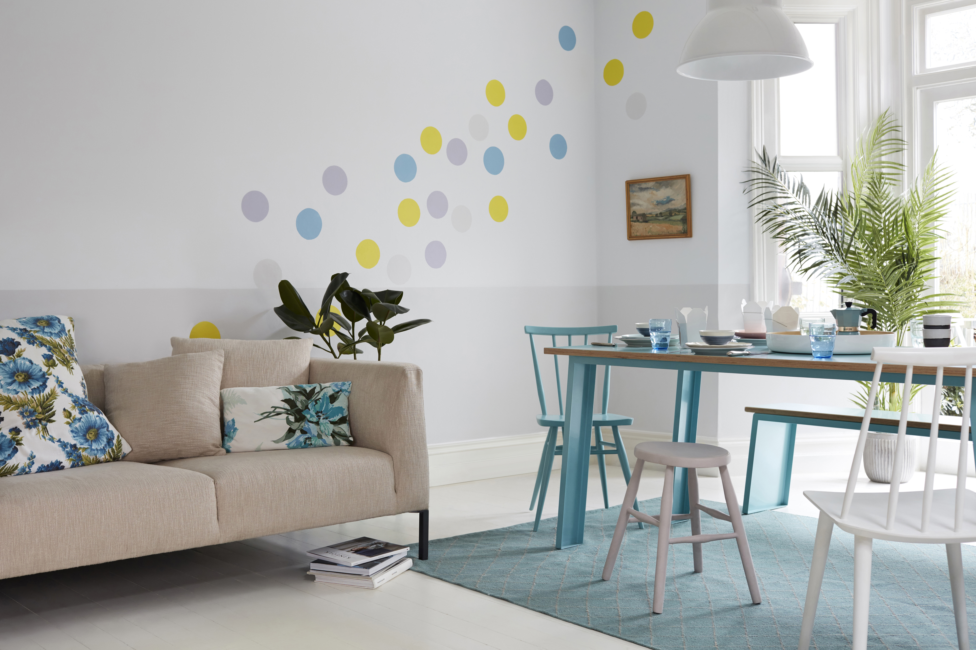 Accents of blue unify an open plan space. (Dulux/PA)