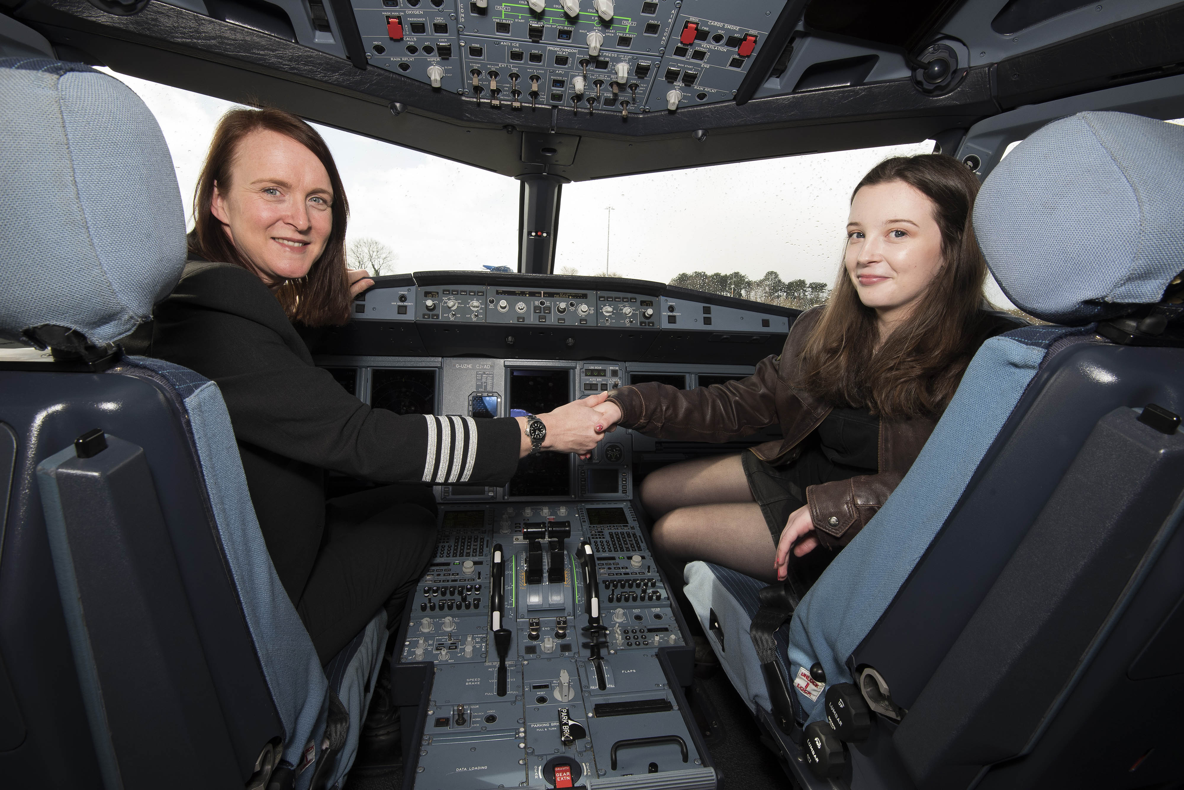 Ellie Carter (right) in a cockpit with her mentor Zoe Ebrey (left) (Neil Munns/PA)