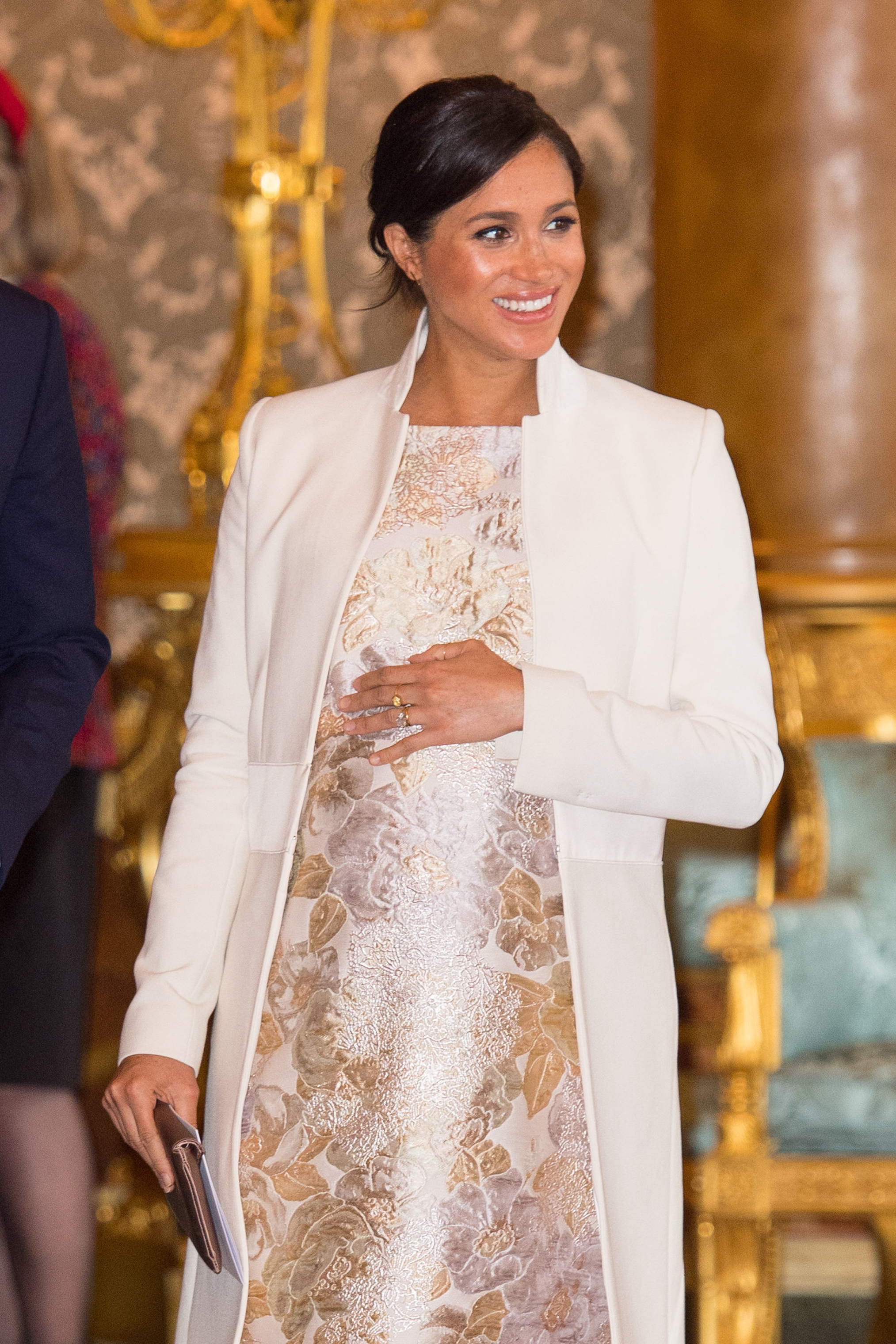 The Duchess of Sussex attends a reception at Buckingham Palace in London to mark the fiftieth anniversary of the investiture of the Prince of Wales.