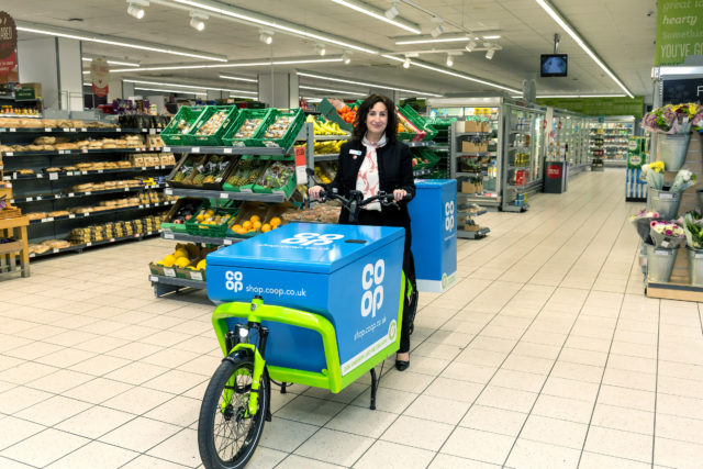 Jo Whitfield, chief executive of Co-op Retail, with one of the delivery bikes. (Joel Chant/UNP Ltd)