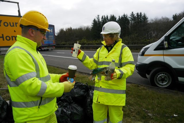 Environment Secretary Roseanna Cunningham collecting litter from the side of the M9