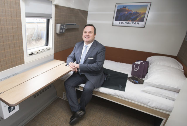 Managing Director of the Caledonian Sleeper Ryan Flaherty in one of the accessible double cabins during its first journey