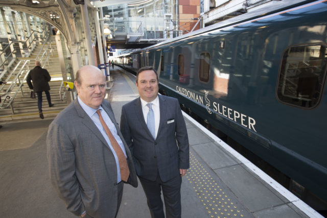 Robert Soames, CEO of Serco, with Caledonian Sleeper MD ahead of its maiden journey