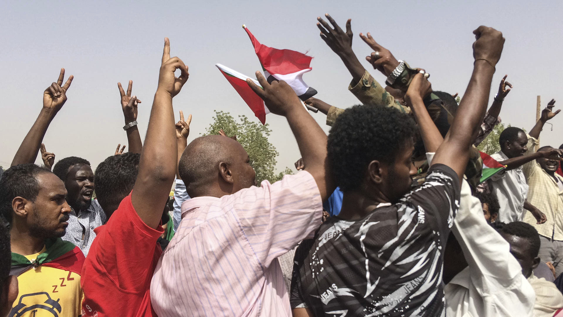Sudanese celebrate after officials said the military had forced longtime autocratic President Omar al-Bashir to step down after 30 years in power in Khartoum, Sudan