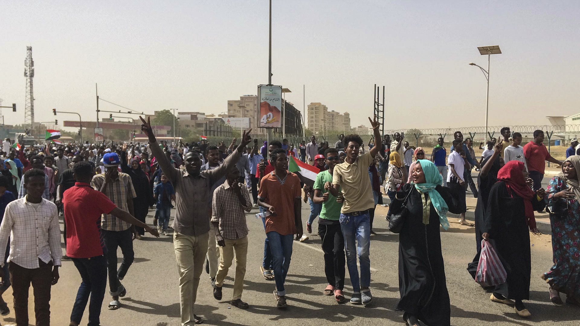 Sudanese celebrate after officials said the military had forced longtime autocratic President Omar al-Bashir to step down after 30 years in power in Khartoum