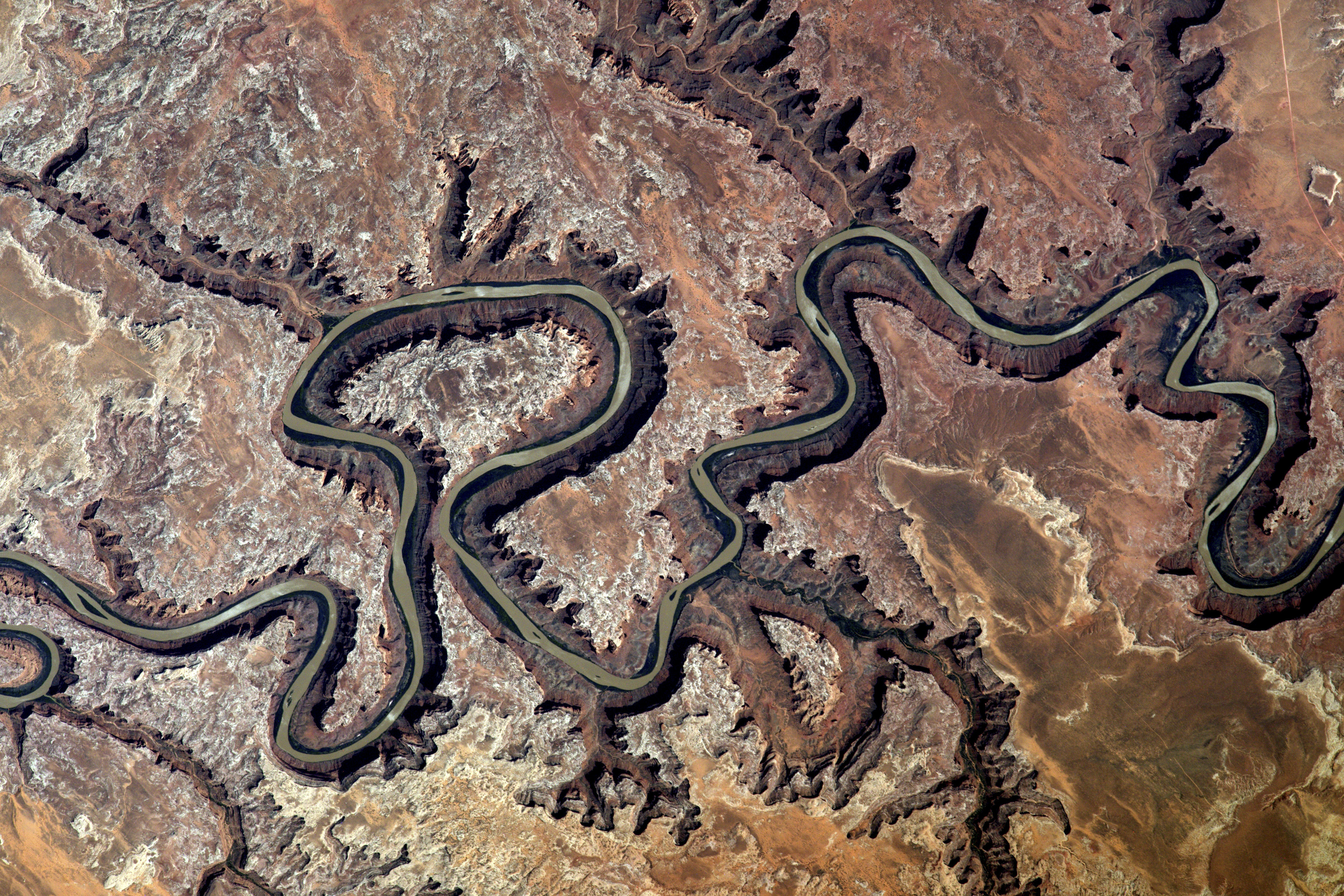 The Green River carves a canyon 300 metres deep as it snakes its way across Utah's landscape (NASA/PA)