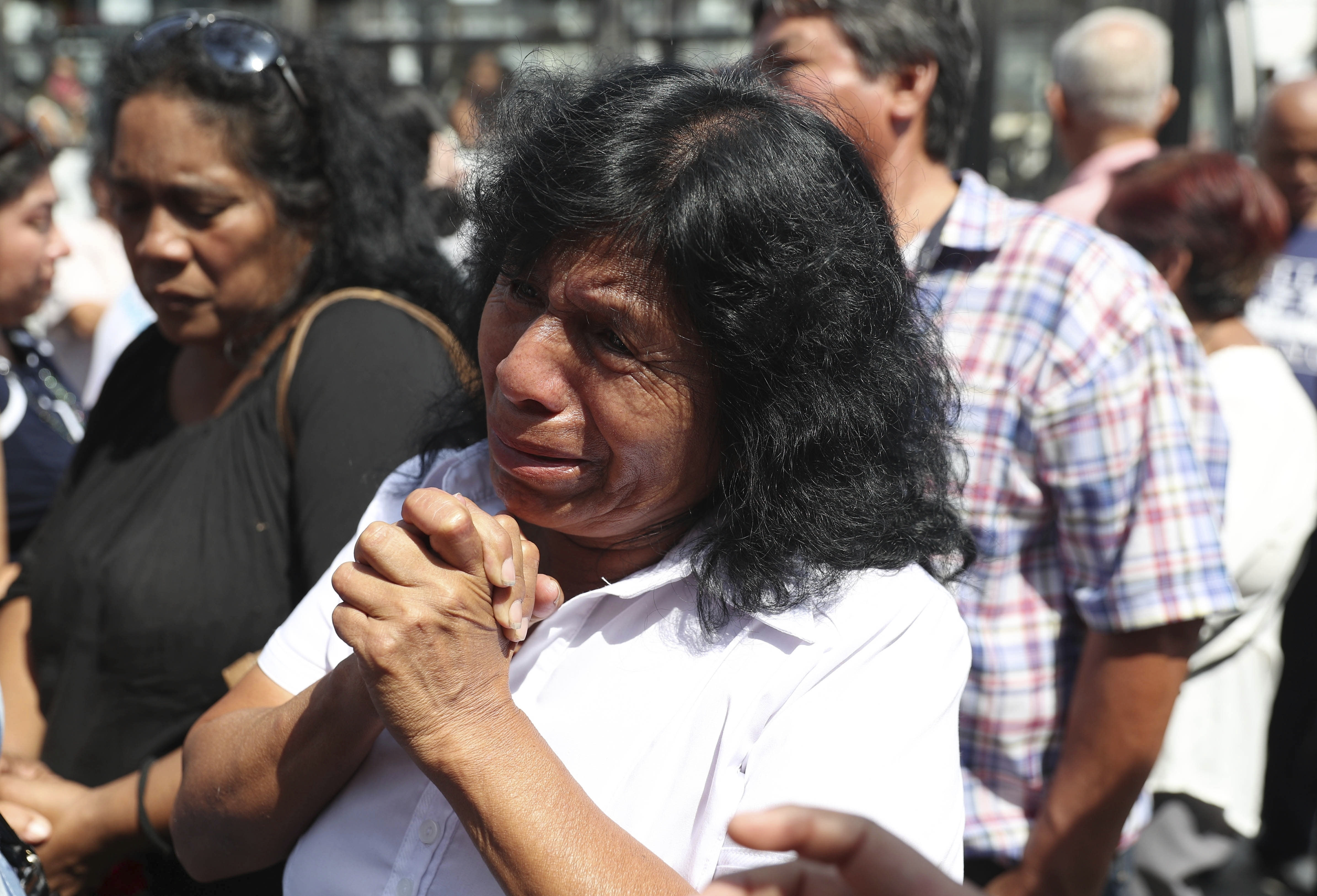 A supporter of former Peruvian President Alan Garcia grieves after learning of his death