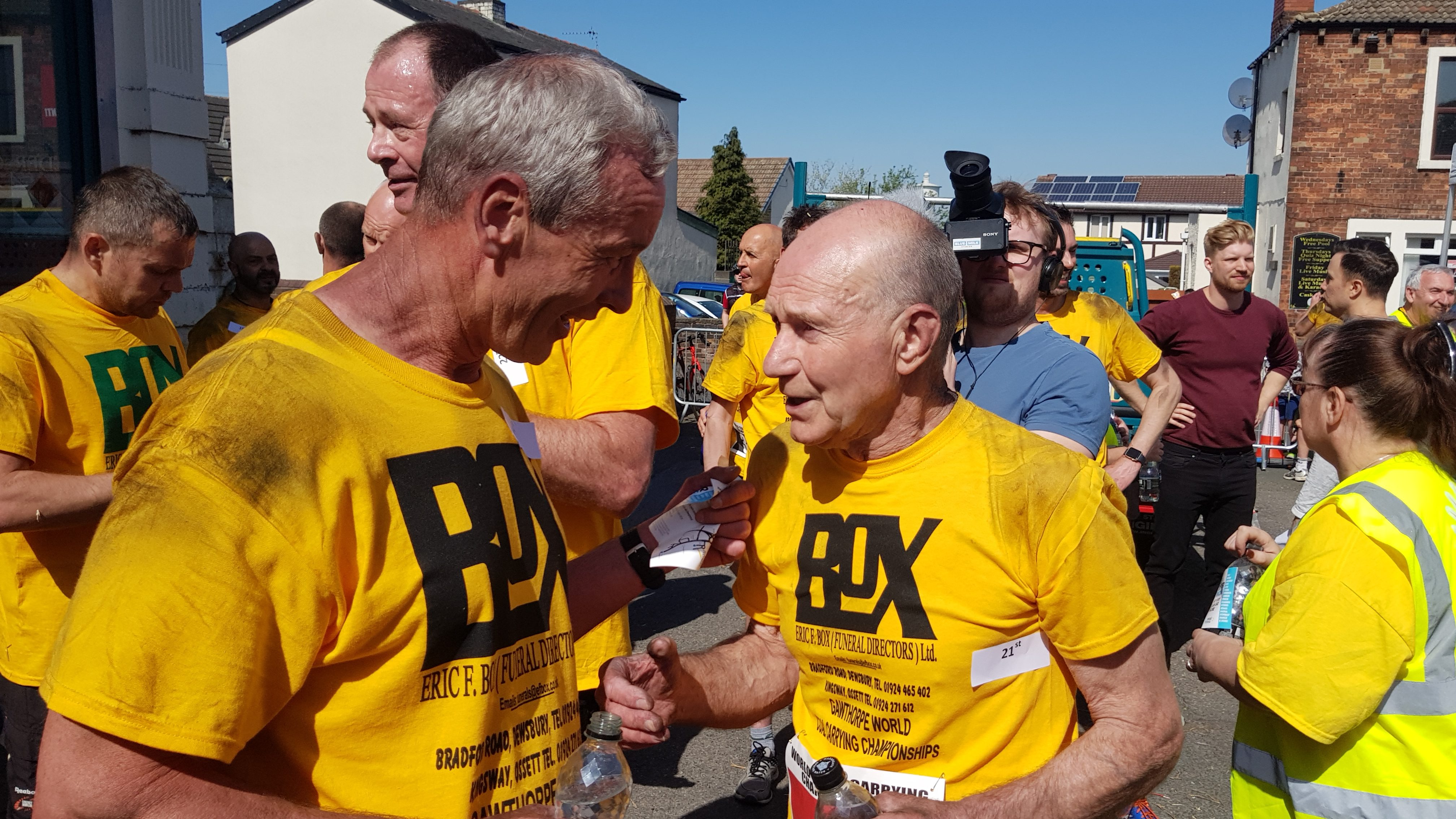 David Page, 72, (right) after winning the race