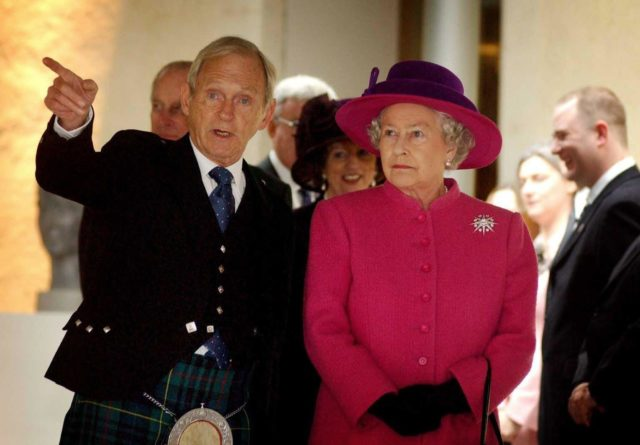 The Queen being shown around Holyrood on opening day by then presiding officer Sir George Reid