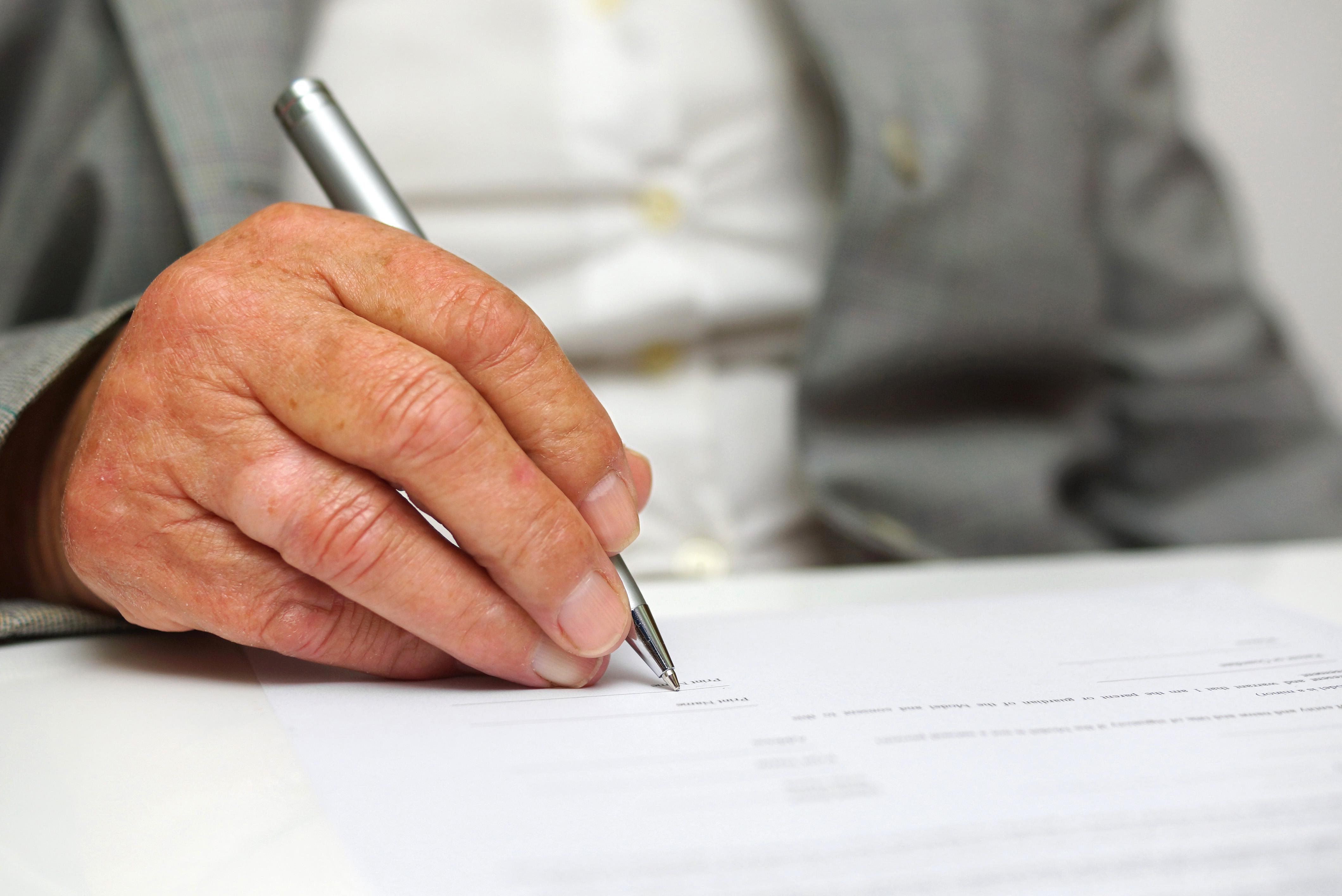 older woman signing the document