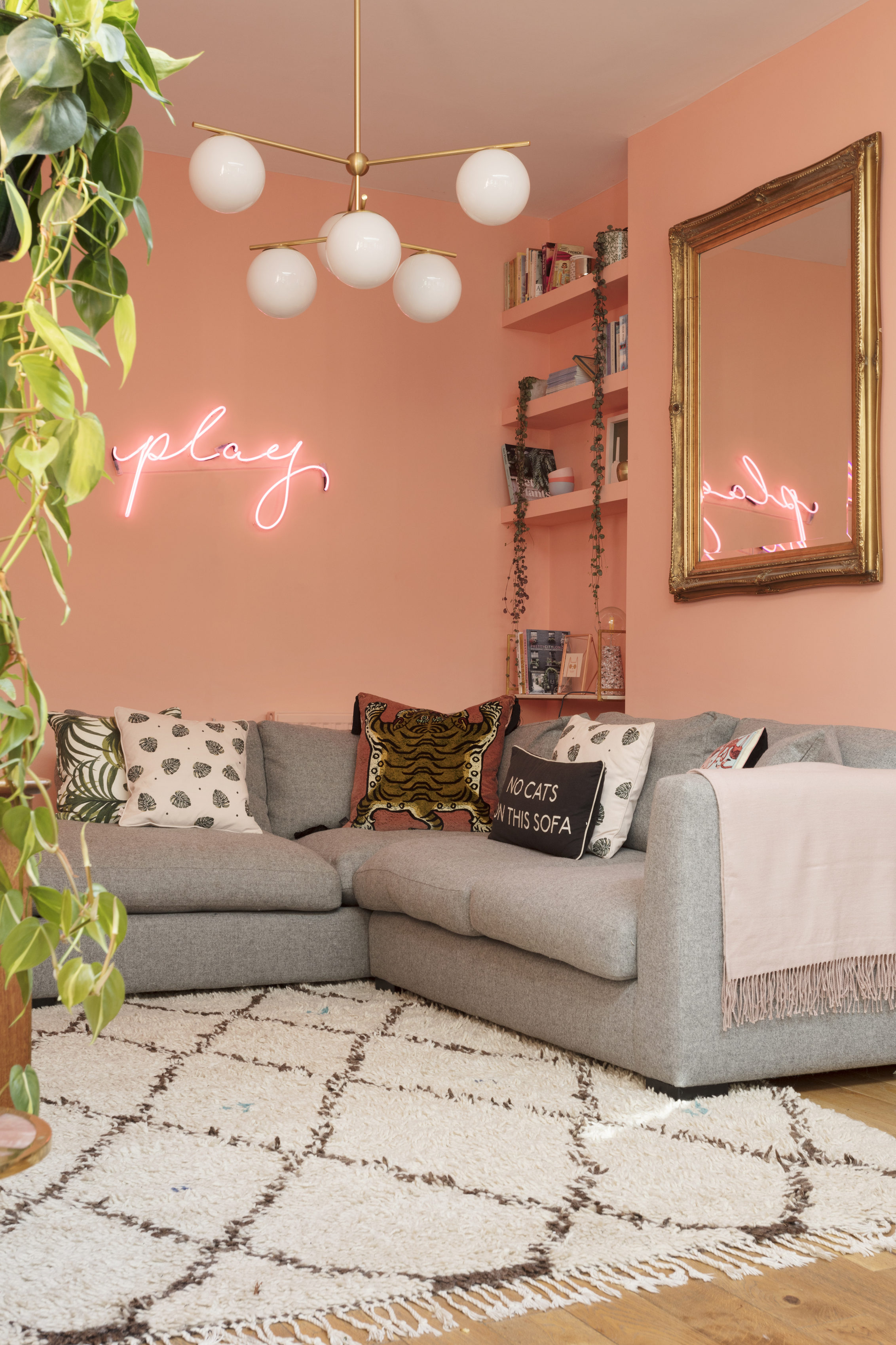 Emily Murray's living room painted in a vibrant peachy pink. ((Susie Lowe/Ryland Peters & Small/PA)