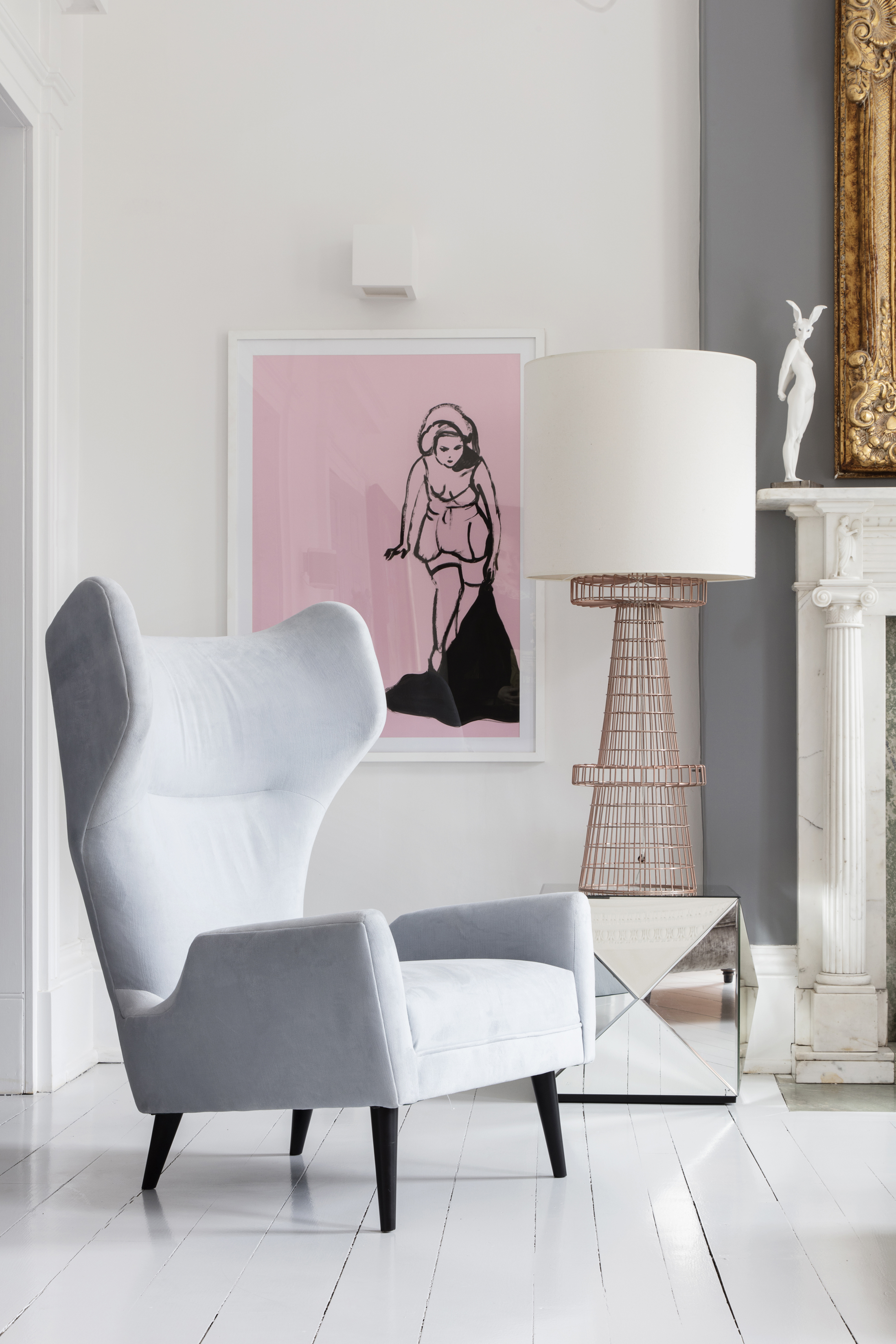 One pink print adds drama to a pared back space which features in Pink House Living: For People Cheating On Fashion With Furniture (Susie Lowe/Ryland Peters & Small/PA)
