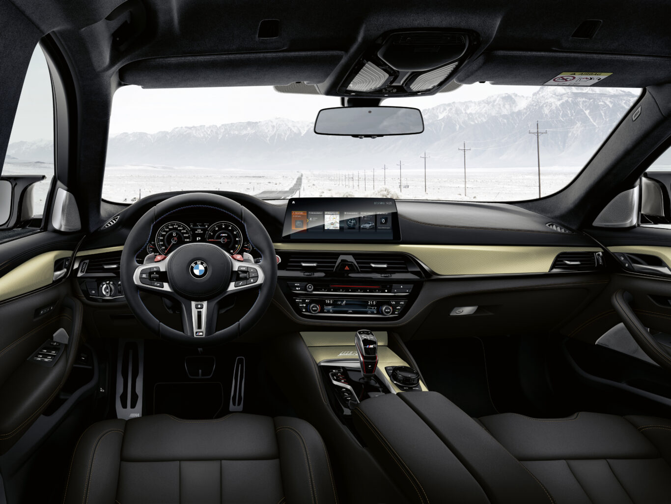 The interior of the car features a striking gold finish
